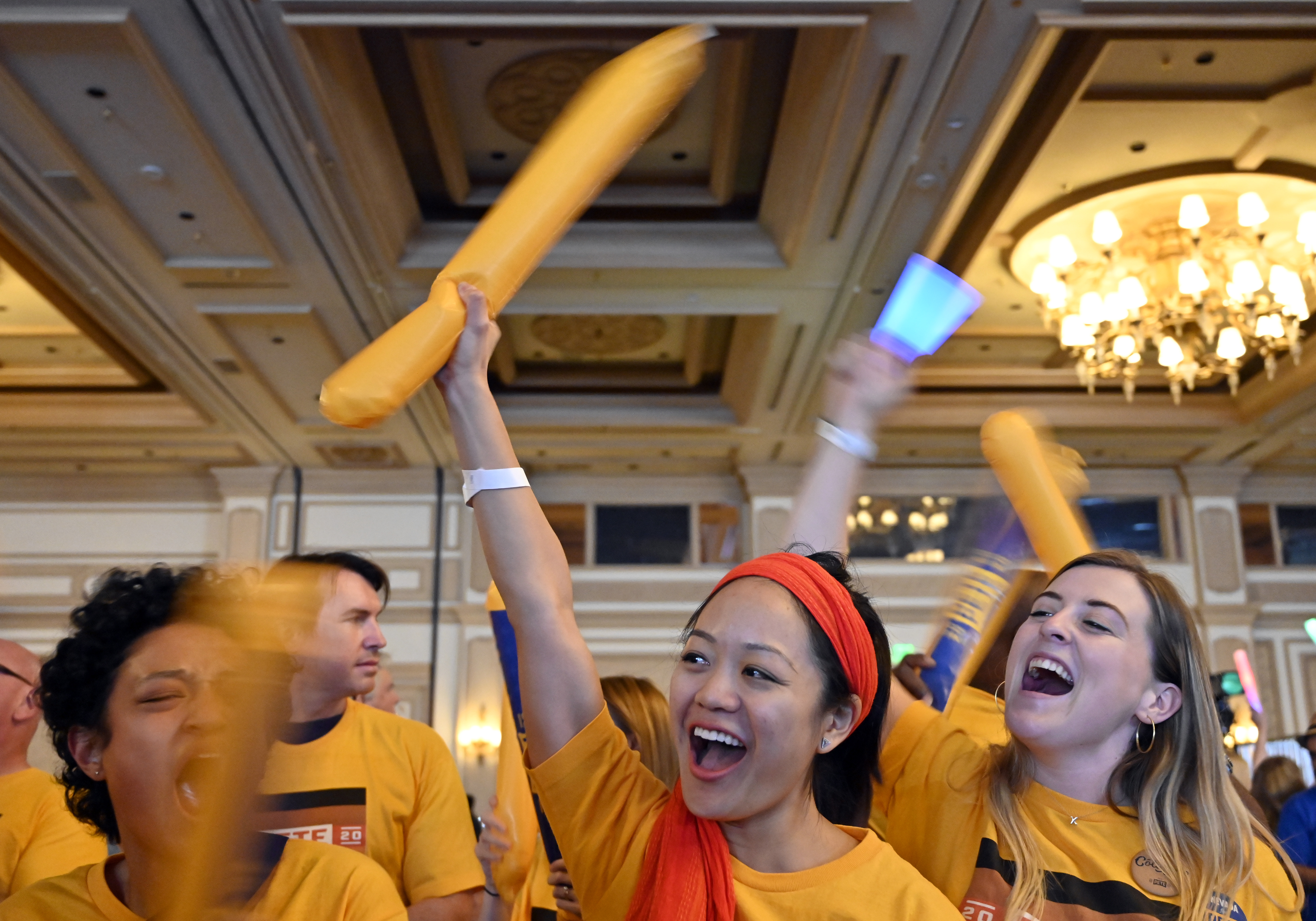 "LAS VEGAS, NEVADA - NOVEMBER 17: Lynne Guey (C), a supporter of Democratic presidential candidate, South Bend, Indiana Mayor Pete Buttigieg, cheers during the Nevada Democrats' ""First in the West"" event at Bellagio Resort & Casino on November 17, 2019 in Las Vegas, Nevada. The Nevada Democratic presidential caucuses is scheduled for February 22, 2020. (Photo by David Becker/Getty Images)"