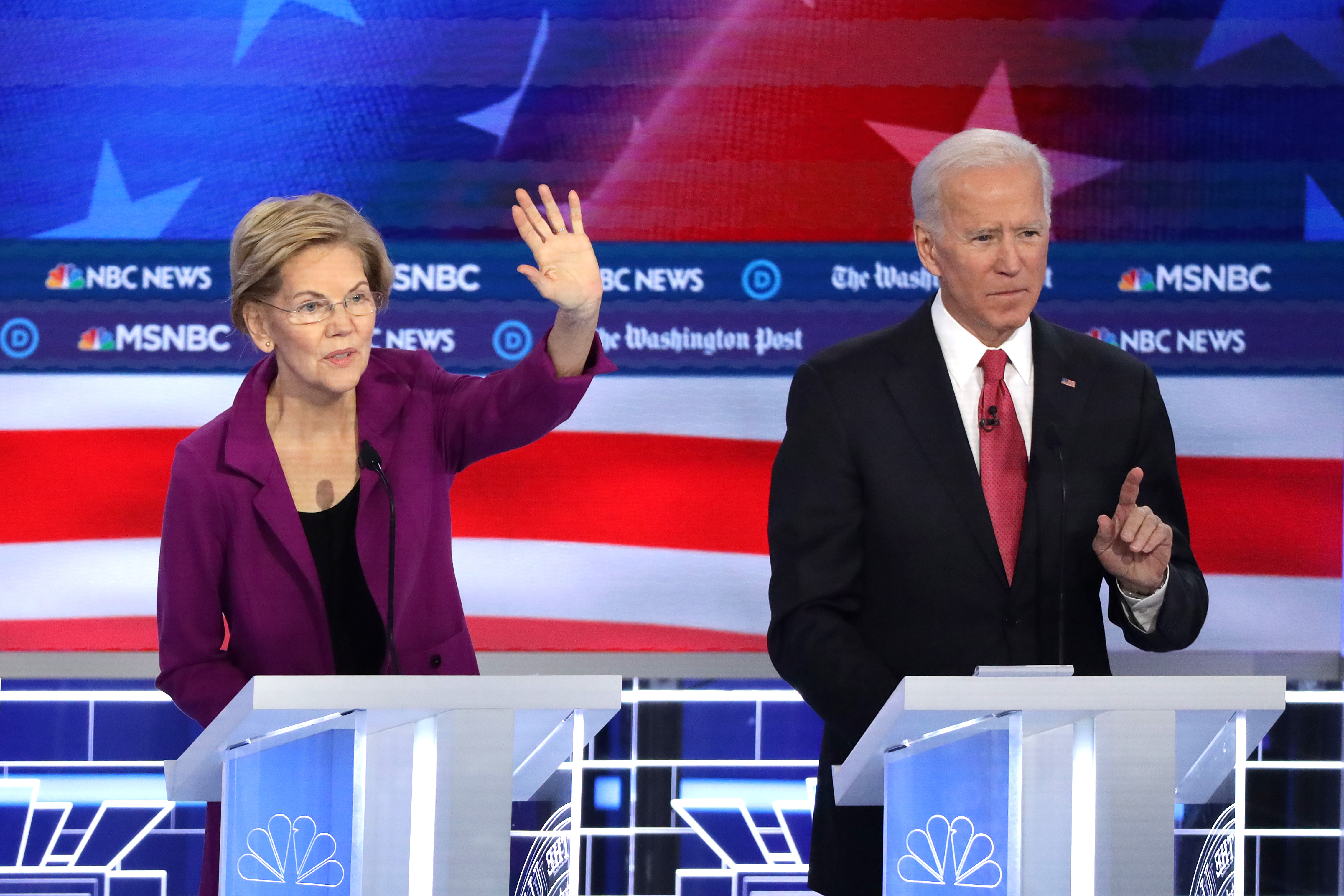 Elizabeth Warren (D-MA) (L) and former Vice President Joe Biden raise their hands during the Democratic Presidential Debate at Tyler Perry Studios November 20, 2019 in Atlanta, Georgia. (Alex Wong/Getty Images)