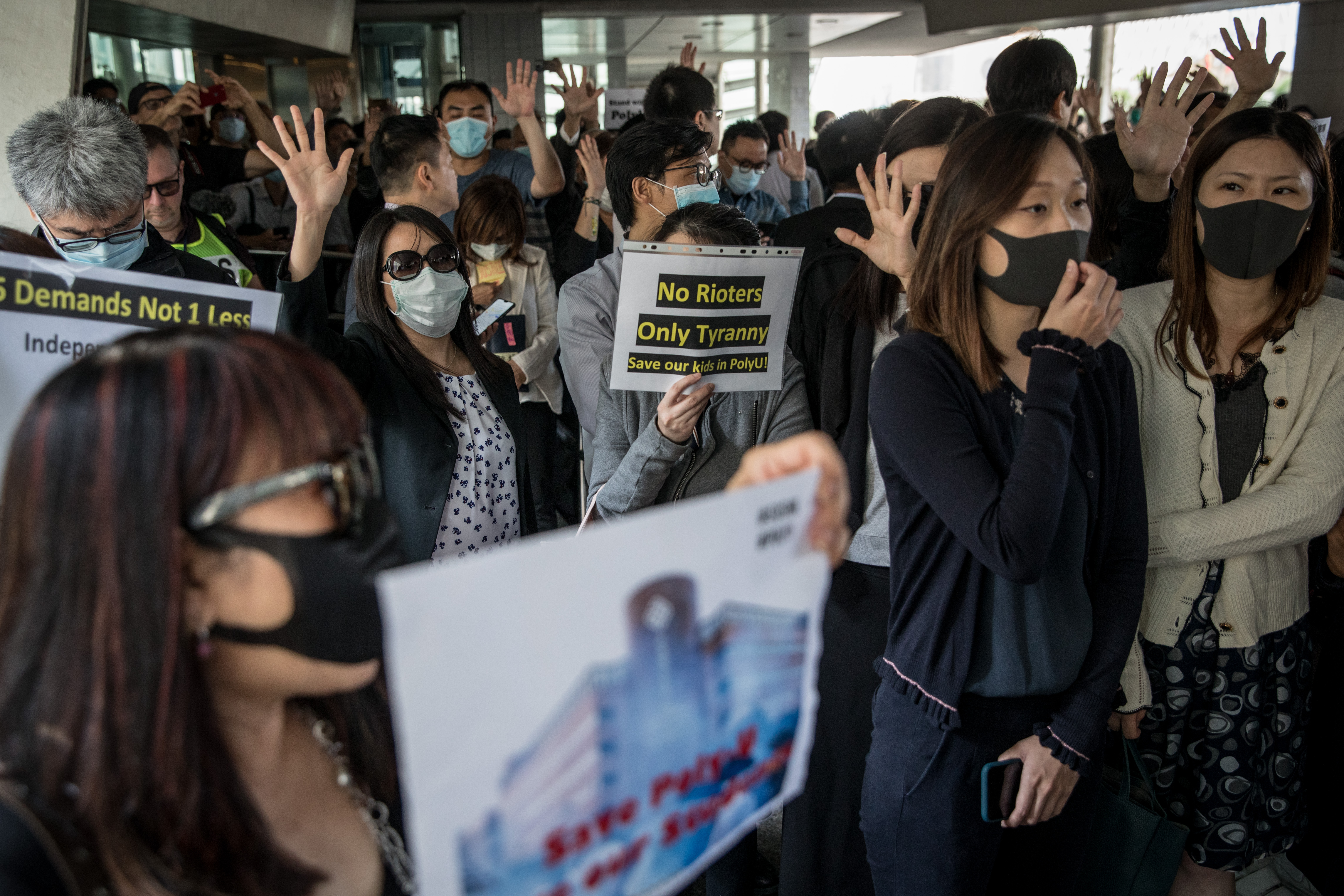 Protesters chant slogans and hold signs on a footbridge in the central business district during a lunch time protest on November 27, 2019 in Hong Kong, China. (Chris McGrath/Getty Images)