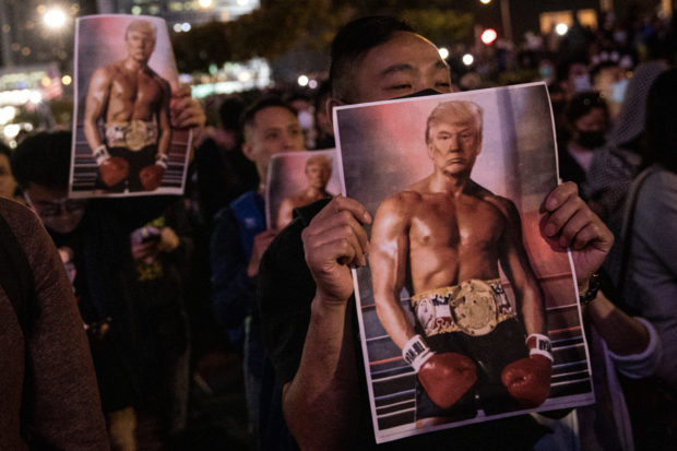 "HONG KONG, CHINA - NOVEMBER 28: Pro-democracy protesters hold posters of US President Donald Trump during a Thanksgiving Day rally at Edinburgh Place on November 28, 2019 in Hong Kong, China. Protesters gathered to say thank you to the United States after US President Donald Trump signed legislation supporting the Hong Kong pro-democracy protesters, with new legislation requiring annual reviews of Hong Kong's rights and freedoms. Demonstrations in Hong Kong have stretched into their sixth month as pro-democracy groups won the recent District Council elections, continuing demands for an independent inquiry into police brutality, the retraction of the word ""riot"" to describe the rallies, and genuine universal suffrage. (Photo by Chris McGrath/Getty Images)"