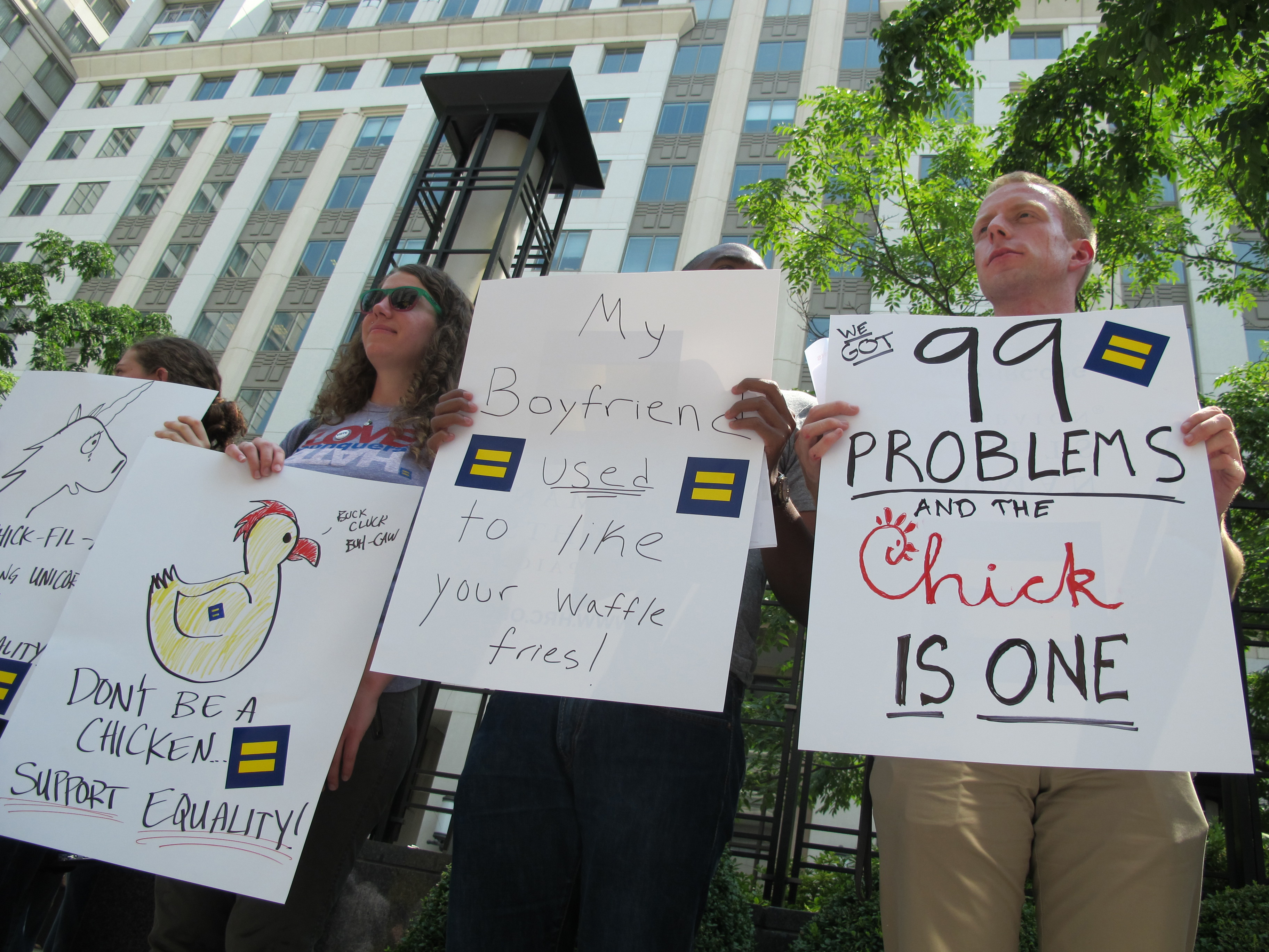 "Protesters hold signs and shout slogans outside a Chick-fil-A food truck in a mid-day demonstration organized by the Human Rights Campaign in Washington on 26 July, 2012 after the fast-food firm's president Dan Cathy came out against marriage equality in the United States. The protesters accused Chick-fil-A of a long history of supporting groups that ""demonize"" gay and lesbian people. Cathy told a Christian news journal that Americans have invited God's judgement by accepting same-sex marriage. AFP PHOTO/Robert MACPHERSON (Photo credit should read Robert MacPherson/AFP/GettyImages)"