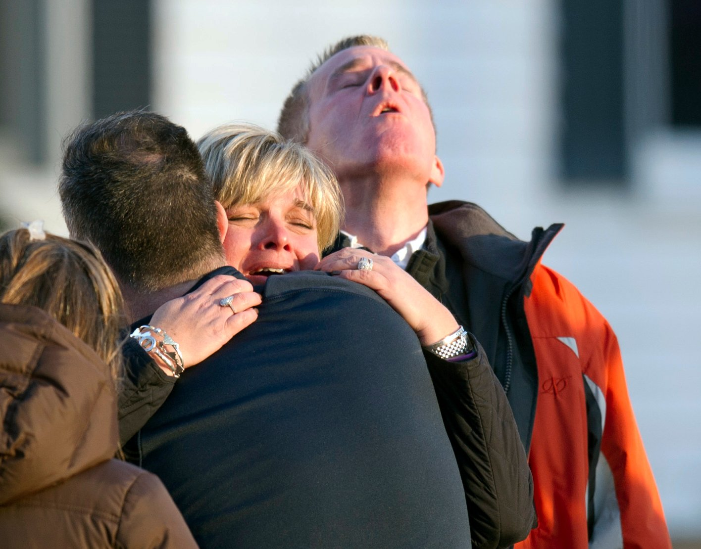 Family members after hearing news of their loved ones from officials December 14, 2012 in Newtown, Connecticut following the Sandy Hook school shooting. (DON EMMERT/AFP via Getty Images)