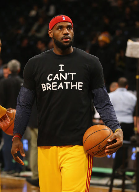 """NEW YORK, NY - DECEMBER 08: LeBron James #23 of the Cleveland Cavaliers wears an """"I Can't Breathe"""" shirt during warmups before his game against the Brooklyn Nets during their game at the Barclays Center on December 8, 2014 in New York City. (Photo by Al Bello/Getty Images)"""