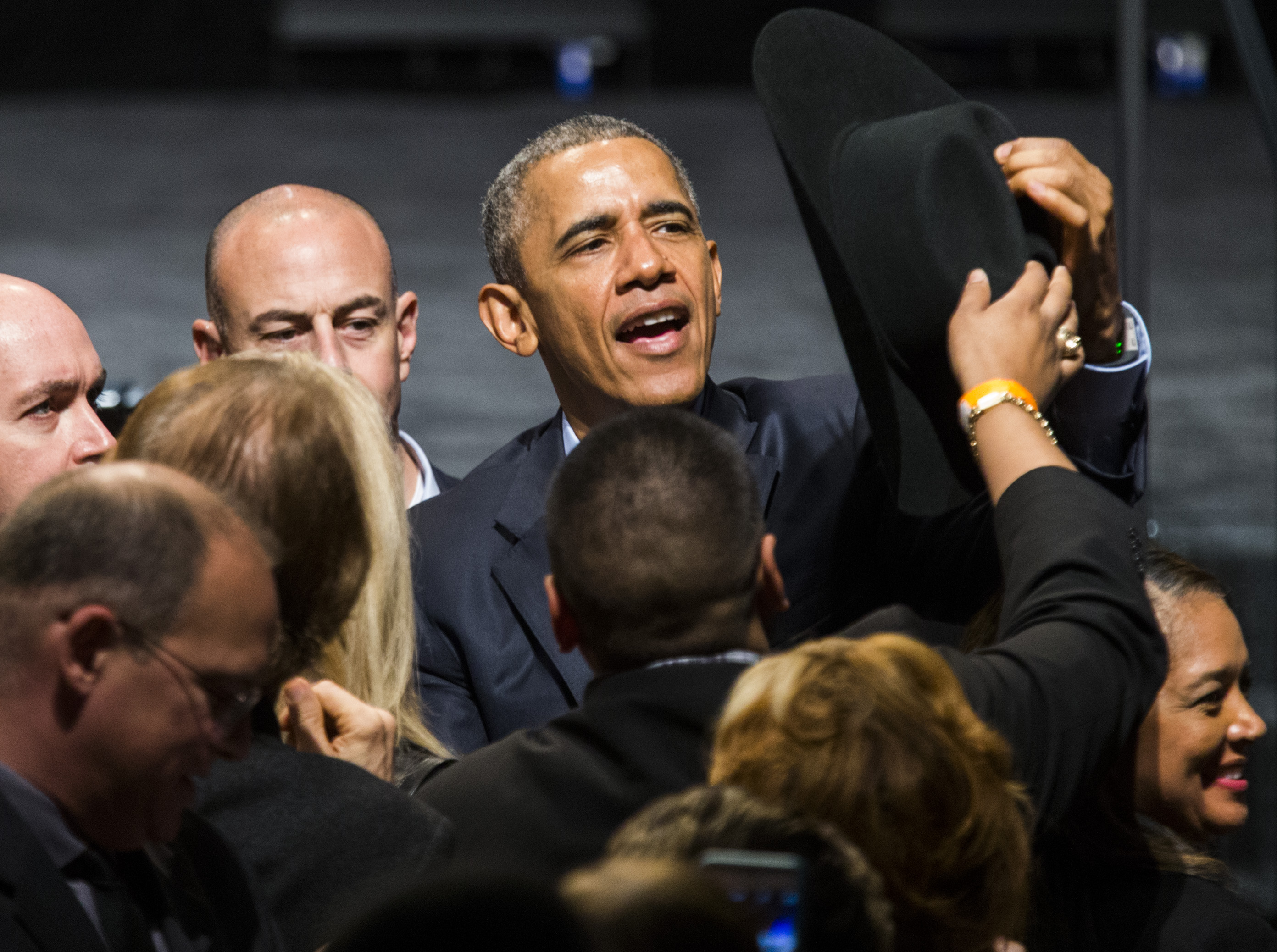 President Barack Obama tries on a cowboy hat from a member of the crowd after speaking at a private Democratic National Committee event at Gilley's Club Dallas on March 12, 2016 in Dallas, Texas. (Ashley Landis-Pool/Getty Images)