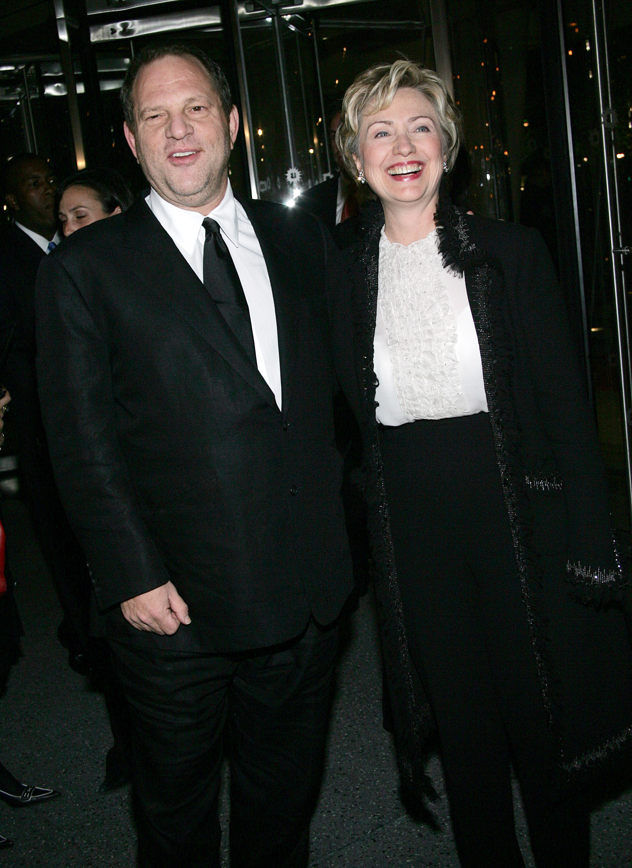 """NEW YORK - OCTOBER 25: Senator Hillary Clinton and Miramax boss Harvey Weinstein arrive at the Brooklyn Museum for the premiere of Miramax Films """"Finding Neverland"""" October 25, 2004 in New York City. (Photo by Evan Agostini/Getty Images)"""