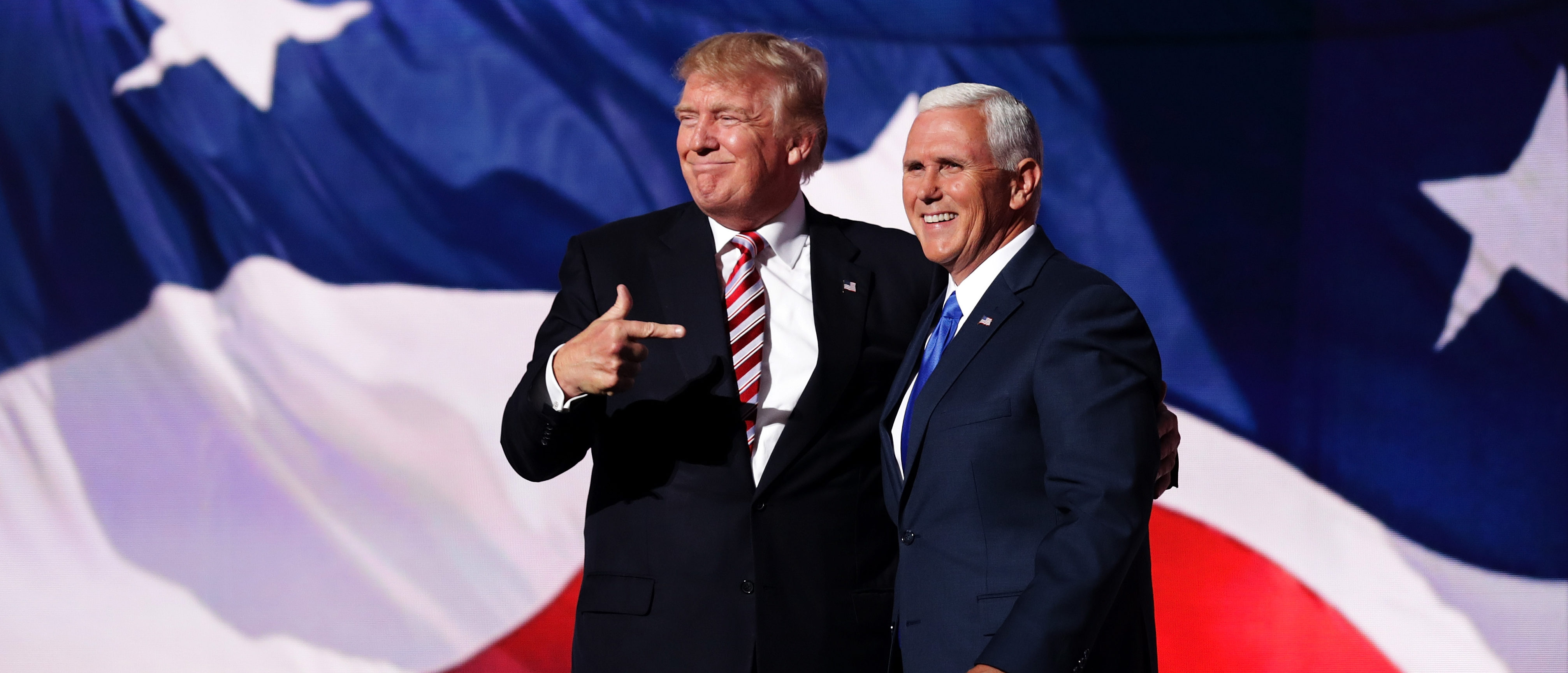 Republican presidential candidate Donald Trump stand with Republican vice presidential candidate Mike Pence and acknowledge the crowd on the third day of the Republican National Convention on July 20, 2016 at the Quicken Loans Arena in Cleveland, Ohio. (Photo by Chip Somodevilla/Getty Images)
