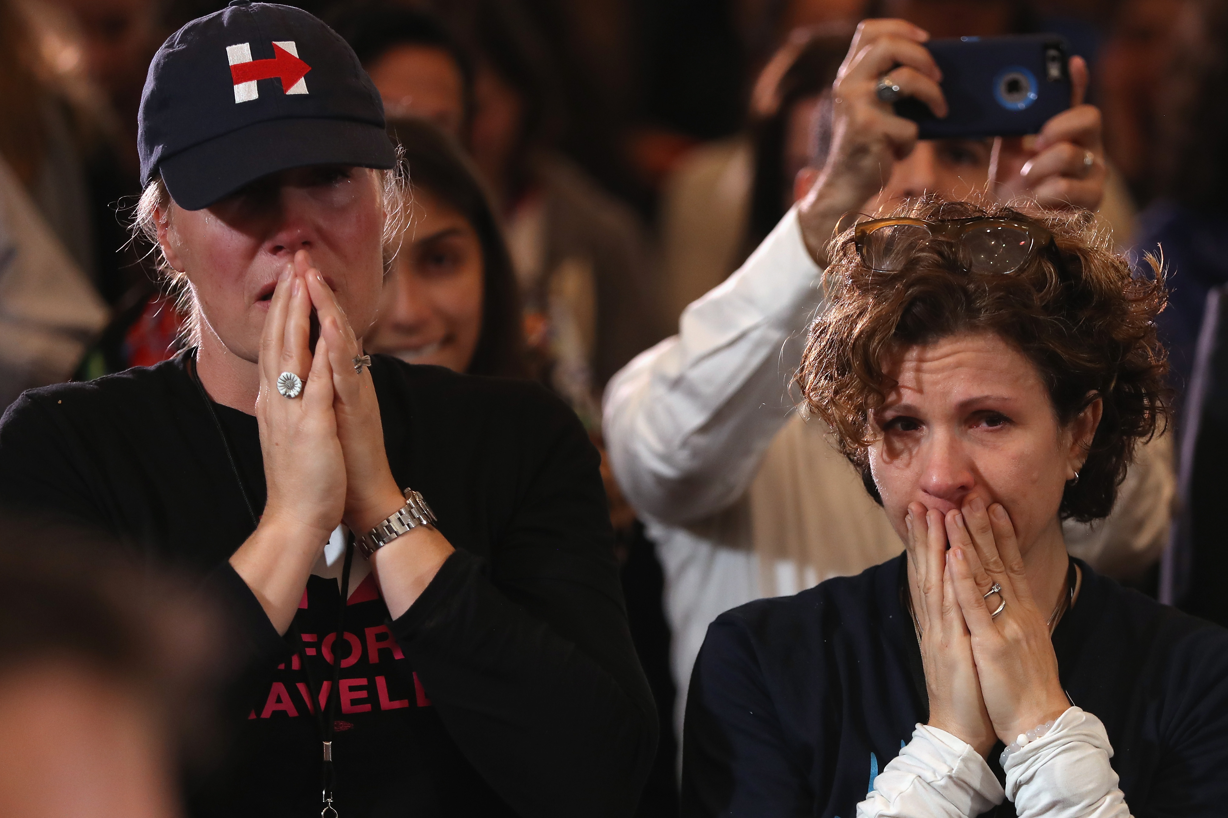 Staffers and supporters react as former Secretary of State Hillary Clinton concedes the presidential election at the New Yorker Hotel on November 9, 2016 in New York City. (Justin Sullivan/Getty Images)