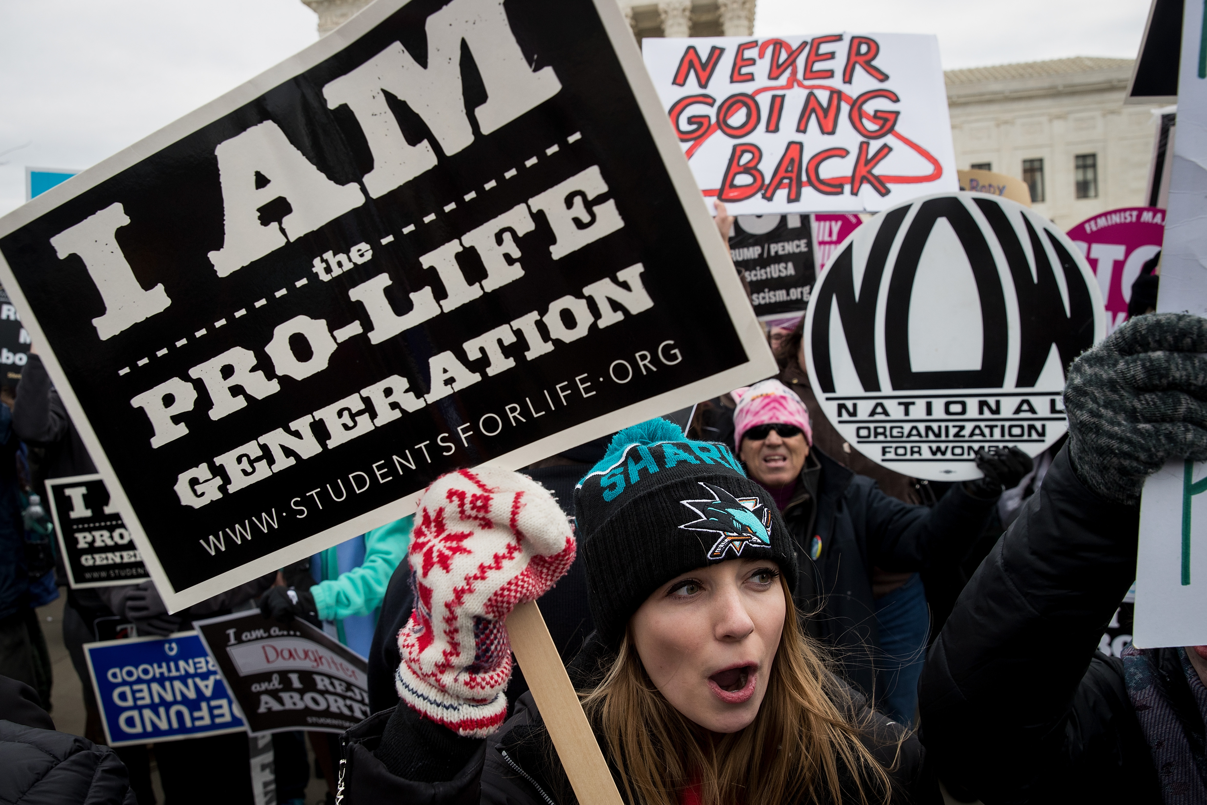 WASHINGTON, DC - JANUARY 27: A mix of anti-abortion advocates and pro-choice advocates rally outside of the Supreme Court during the March for Life, January 27, 2017 in Washington, DC. This year marks the 44th anniversary of the landmark Roe v. Wade Supreme Court case, which established a woman's constitutional right to an abortion. (Photo by Drew Angerer/Getty Images)