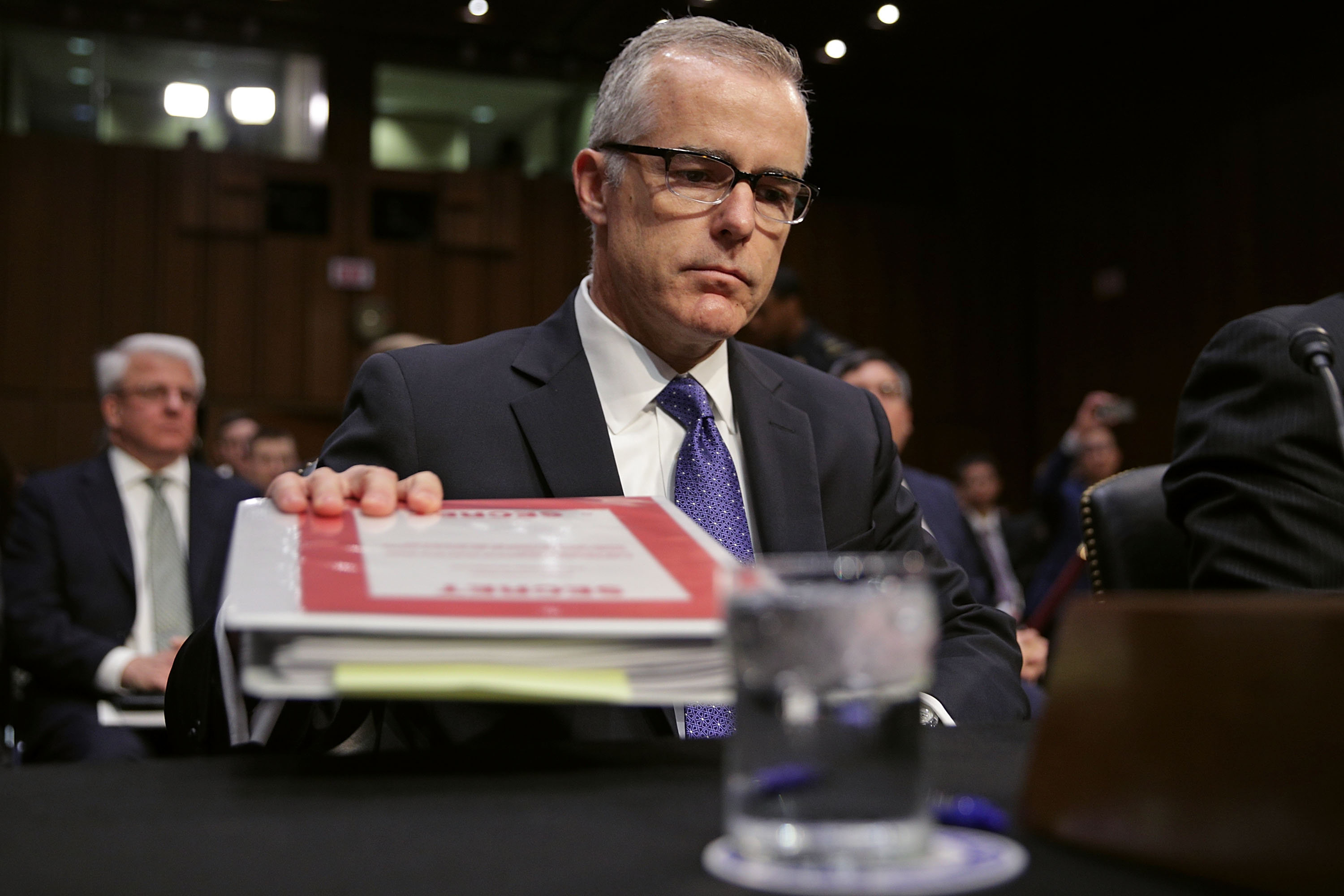 WASHINGTON, DC - MAY 11: Acting FBI Director Andrew McCabe and the other heads of the U.S. intelligence agencies prepare to testify before the Senate Intelligence Committee in the Hart Senate Office Building on Capitol Hill May 11, 2017 in Washington, DC. The intelligence officials were questioned by the committee during the annual hearing about world wide threats to United States' security. (Photo by Alex Wong/Getty Images)
