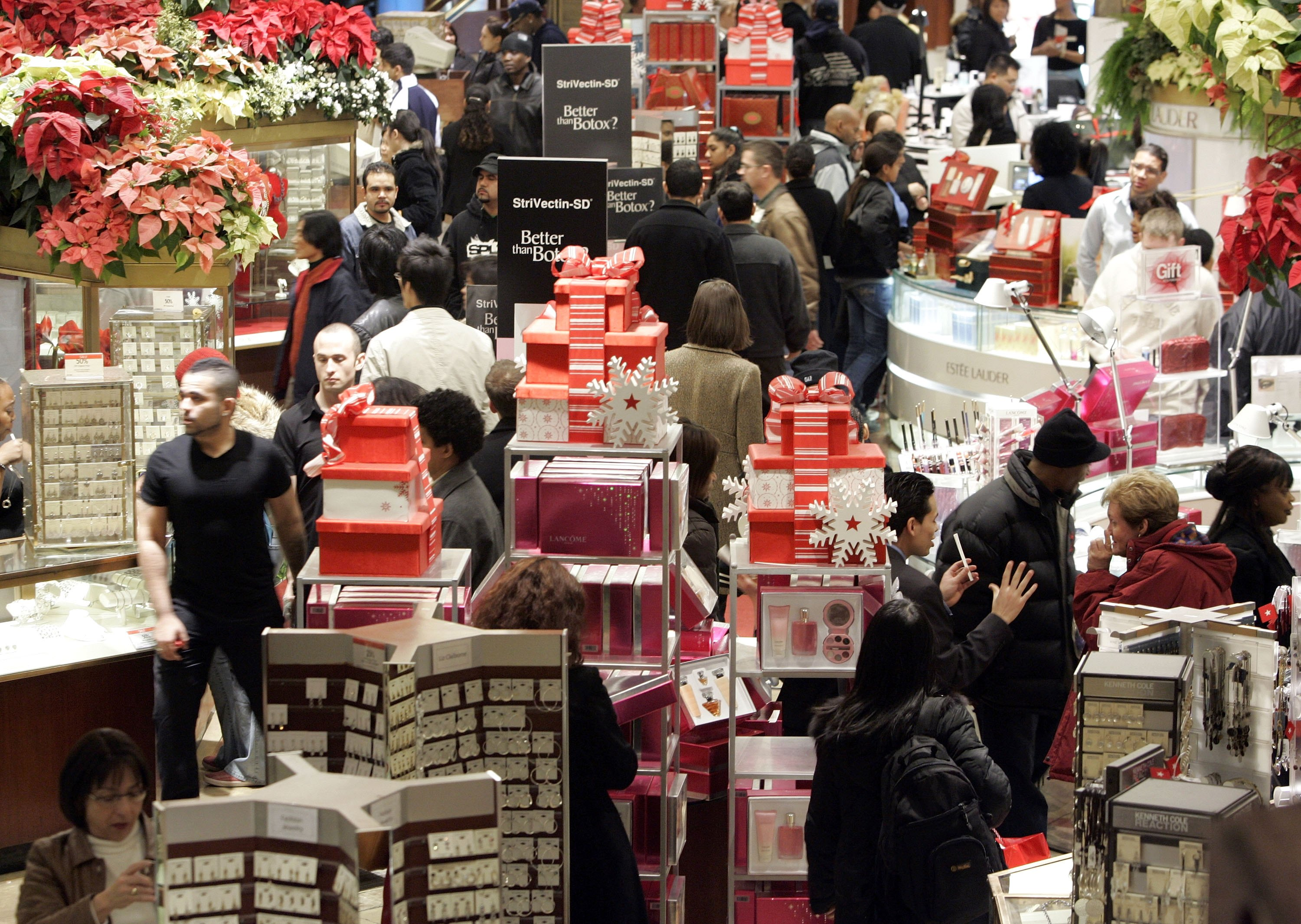 Last minute shoppers peruse merchandise at Macy's December 24, 2006 in New York City. (Photo by Stephen Chernin/Getty Images)