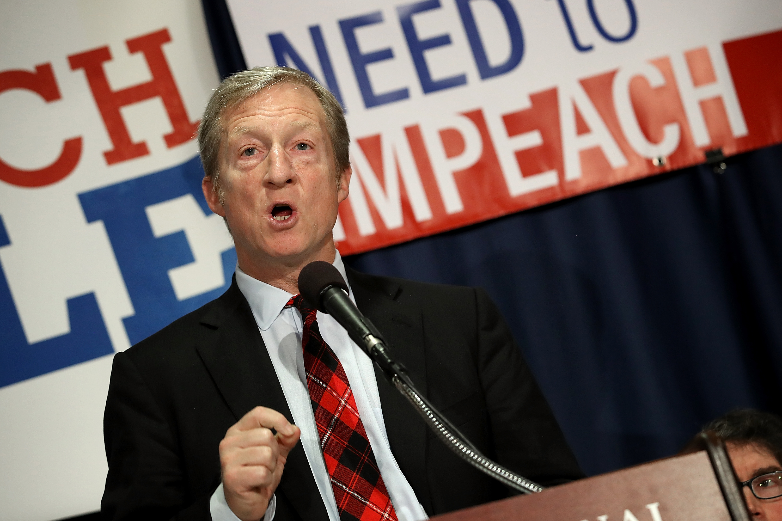 Billionaire hedge fund manager and philanthropist Tom Steyer speaks during a press conference at the National Press Club December 6, 2017 . (Win McNamee/Getty Images)