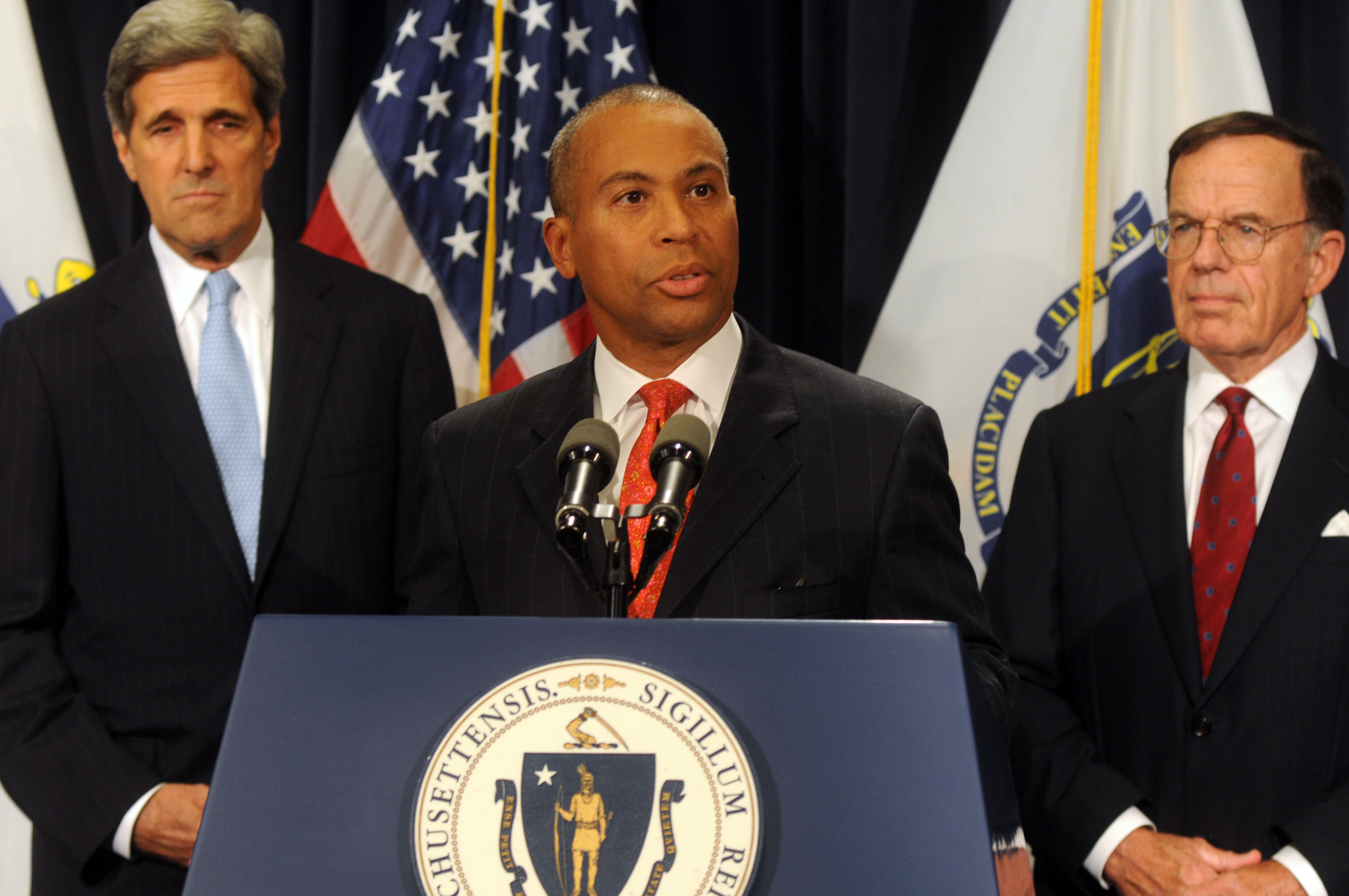 BOSTON, MA - SEPTEMBER 24: Massachusetts Democratic Governor Deval Patrick (C) speaks as U.S. Senator John Kerry (D-MA) (L) and Interim Senator Paul G. Kirk Jr. (D-MA) look on at a press conference on September 24, 2009 at the Statehouse in Boston, Massachusetts. Kirk, the former Democratic National Committee (DNC) chairman, will take over Sen. Edward M. Kennedy's seat that was left vacated from his passing on August 25. (Photo by Darren McCollester/Getty Images)