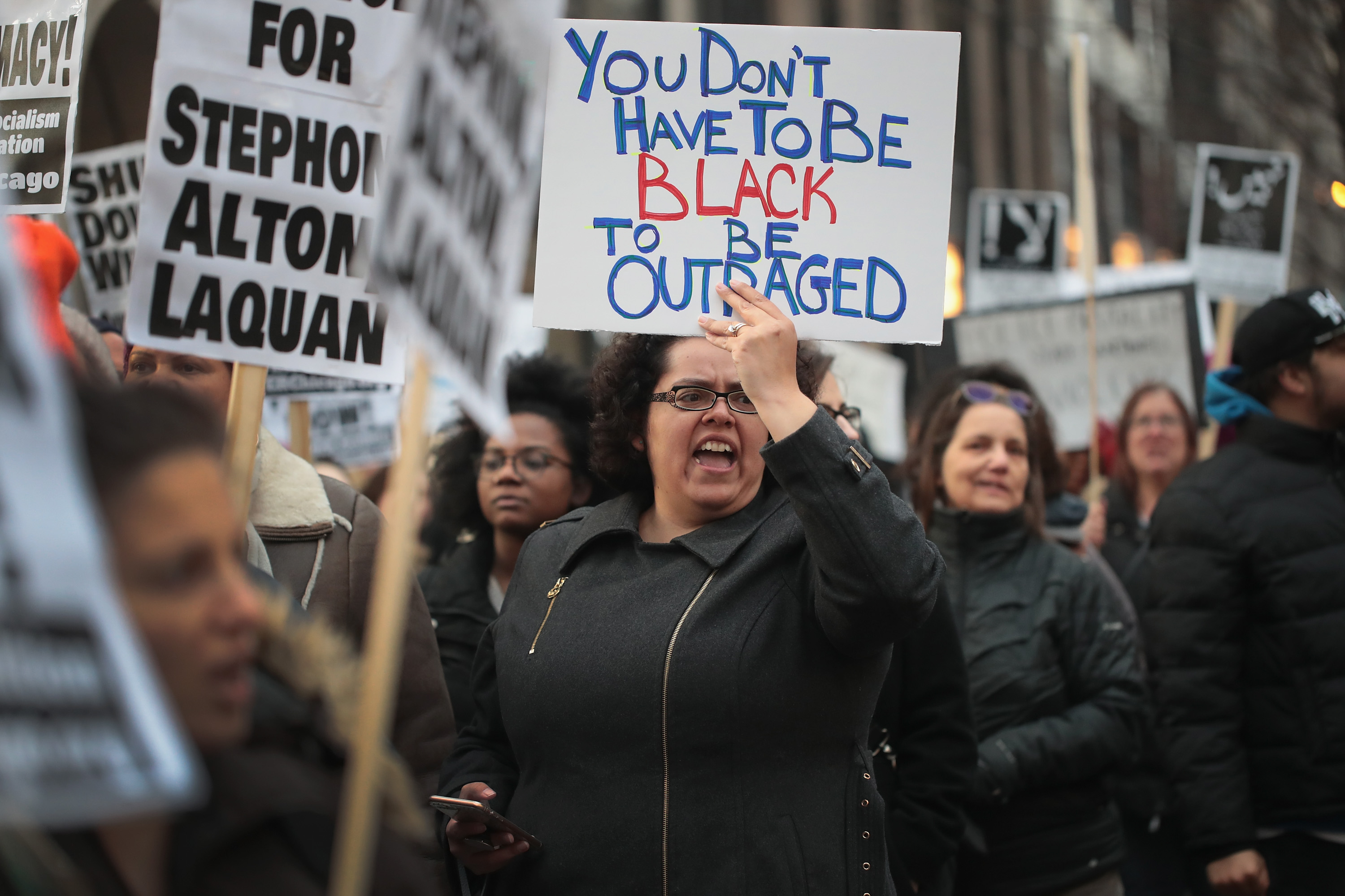 CHICAGO, IL - APRIL 02: In recognition of the 50th anniversary of the death of Dr. Martin Luther King Jr., and in solidarity with the family and supporters of Stephon Clark and others killed by police, demonstrators protest and march in the Magnificent Mile shopping district on April 2, 2018 in Chicago, Illinois. Dr. King was killed on April 4, 1968. (Photo by Scott Olson/Getty Images)