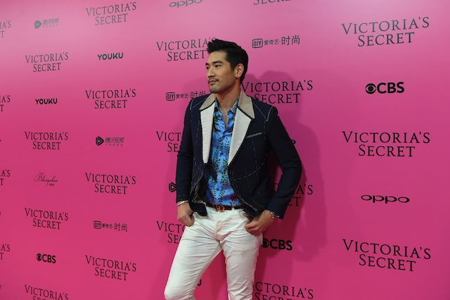 """Canadian actor Godfrey Gao a.k.a. Godfrey Tsao poses on the """"Pink Carpet"""" ahead of the start of the 2017 Victoria's Secret Fashion Show in Shanghai on November 20, 2017. (Photo: CHANDAN KHANNA/AFP via Getty Images)"""