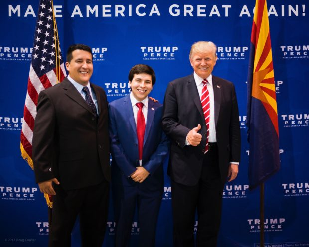 Chris Chavez takes a photo with President Donald Trump in Phoenix, Arizona (Photo provided to the Daily Caller by Chris Chavez)