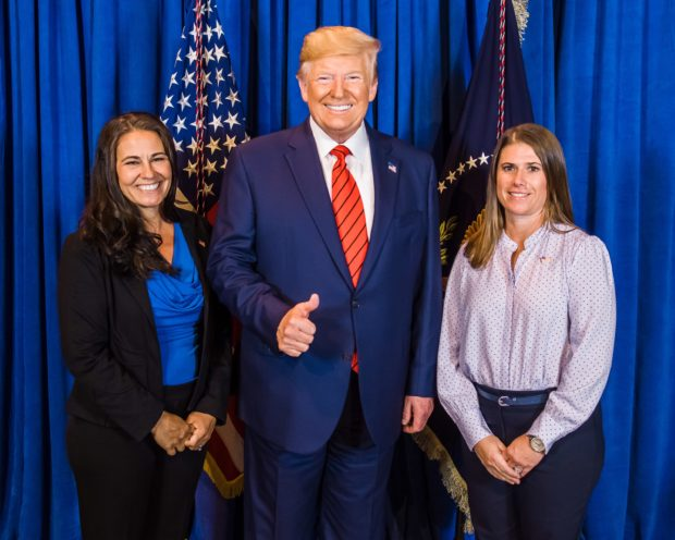 Joanna Kamis (left) and her friend, Kim, take a photo with President Donald Trump at Cipriani in NYC (Photo provided to the Daily Caller by Joanna Kamis)