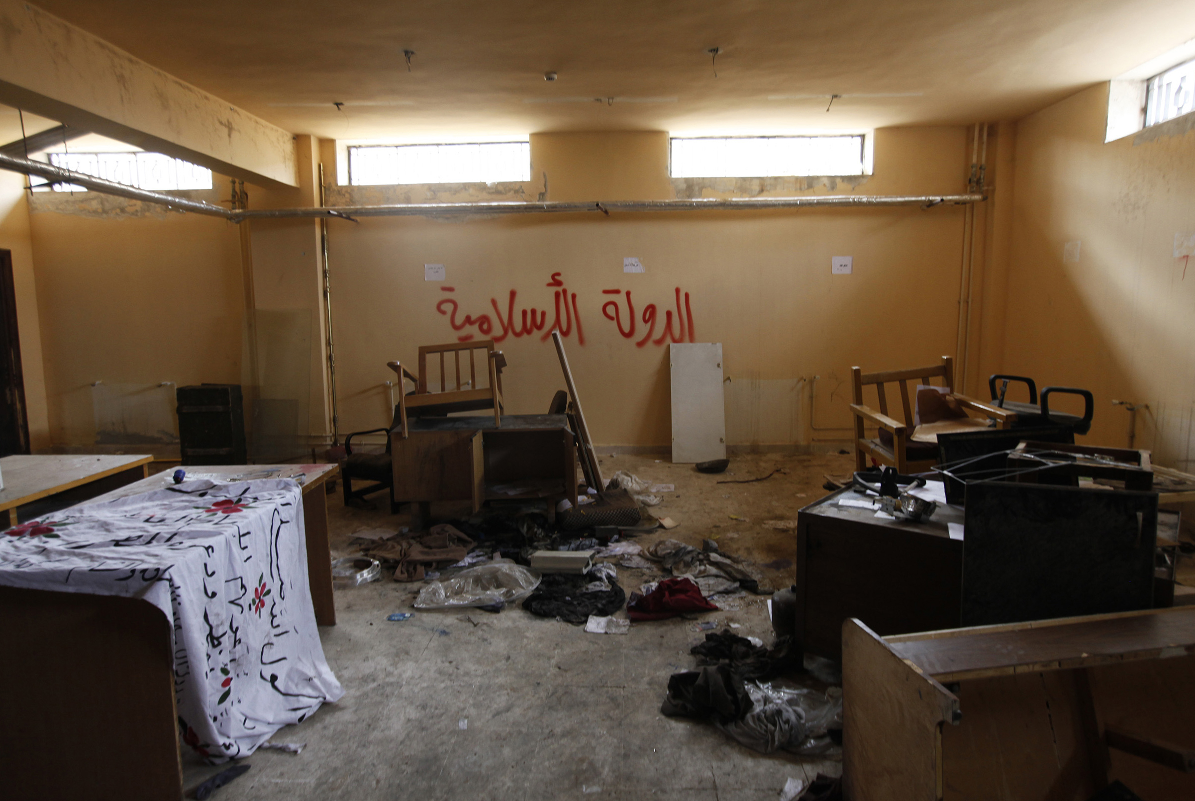 Damage is seen inside a former base used by fighters from the Islamic State in Iraq and the Levant (ISIL), after they withdrew from the town of Azaz, near the Syrian-Turkish border