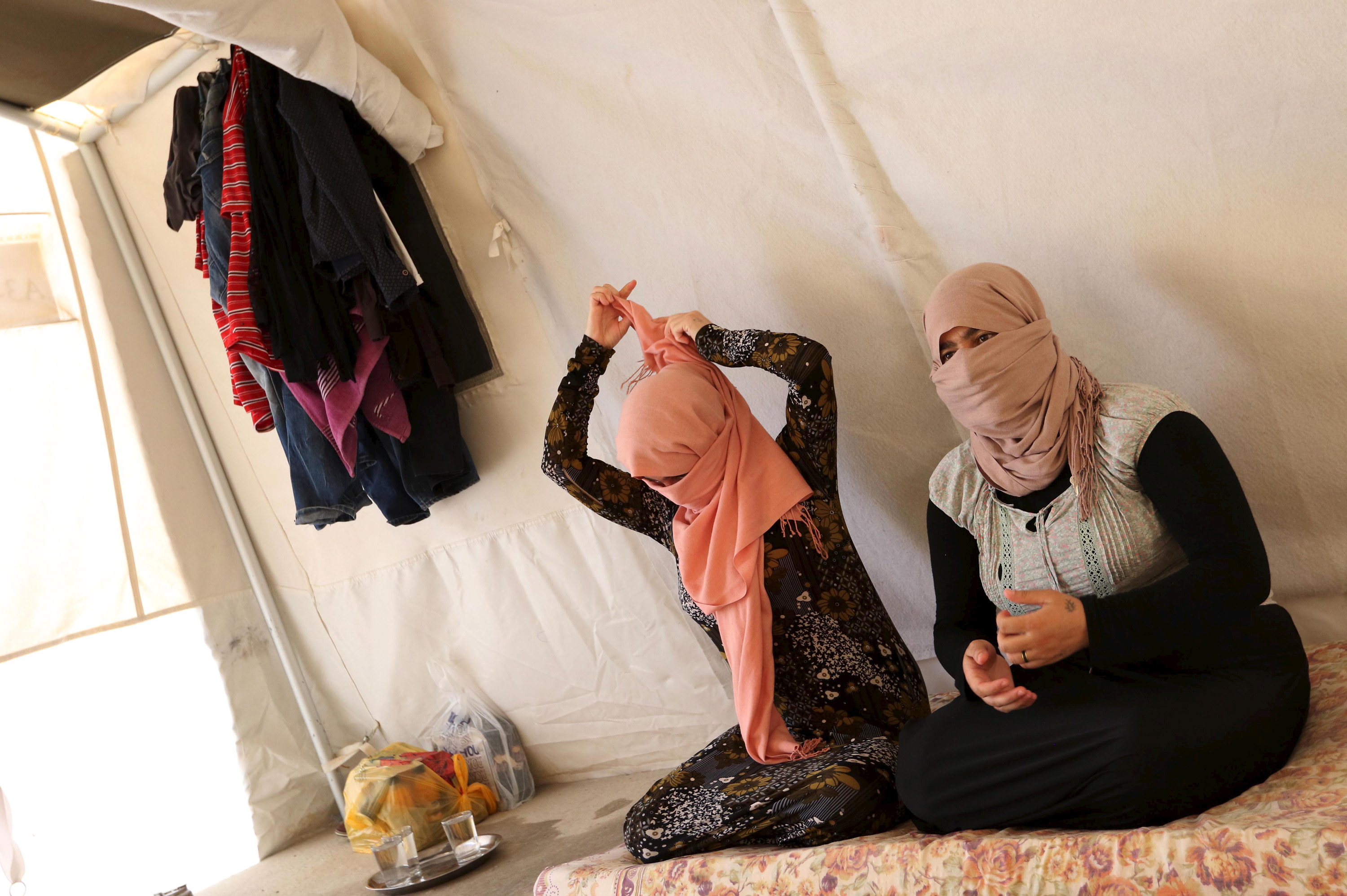 Yazidi sisters, who escaped from captivity by IS militants, sit in tent at Sharya refugee camp on the outskirts of Duhok province