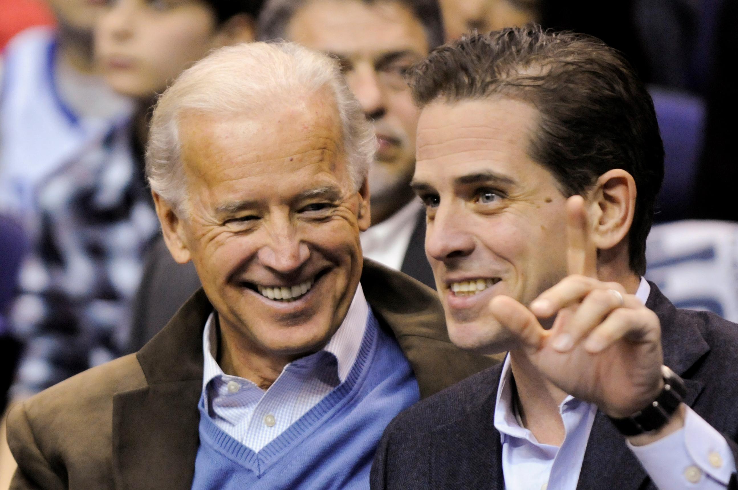 U.S. Vice President Joe Biden and his son Hunter Biden attend an NCAA basketball game between Georgetown University and Duke University in Washington, U.S., Jan. 30, 2010. REUTERS/Jonathan Ernst