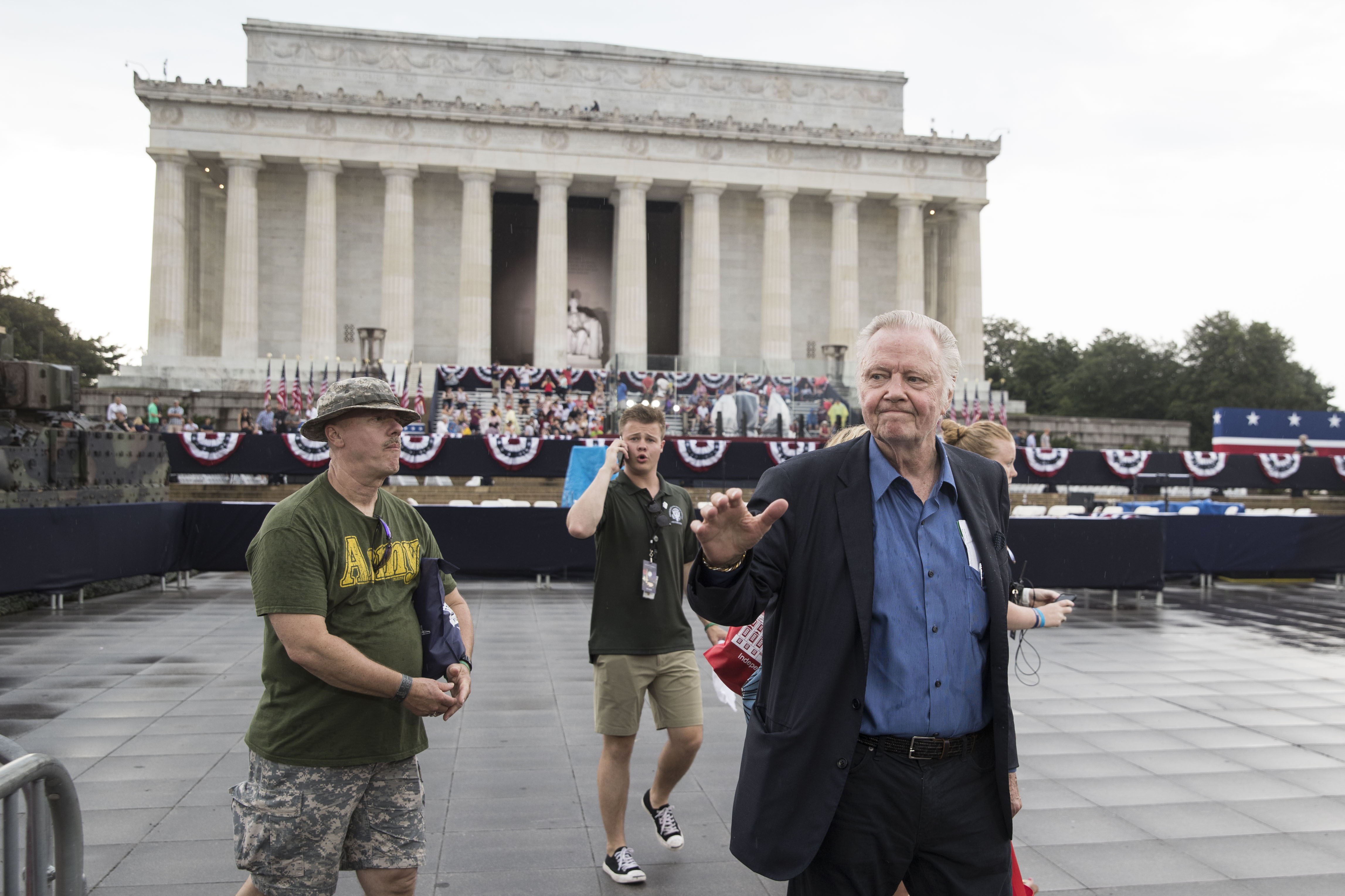 "Actor Jon Voight greets crowds during the opening festivities of President Donald Trump's ""Salute to America"" ceremony in front of the Lincoln Memorial, on July 4, 2019 in Washington, DC. The presentation will feature armored vehicles, a flyover by Air Force One, and several flyovers by other military aircraft. (Photo by Sarah Silbiger/Getty Images)"