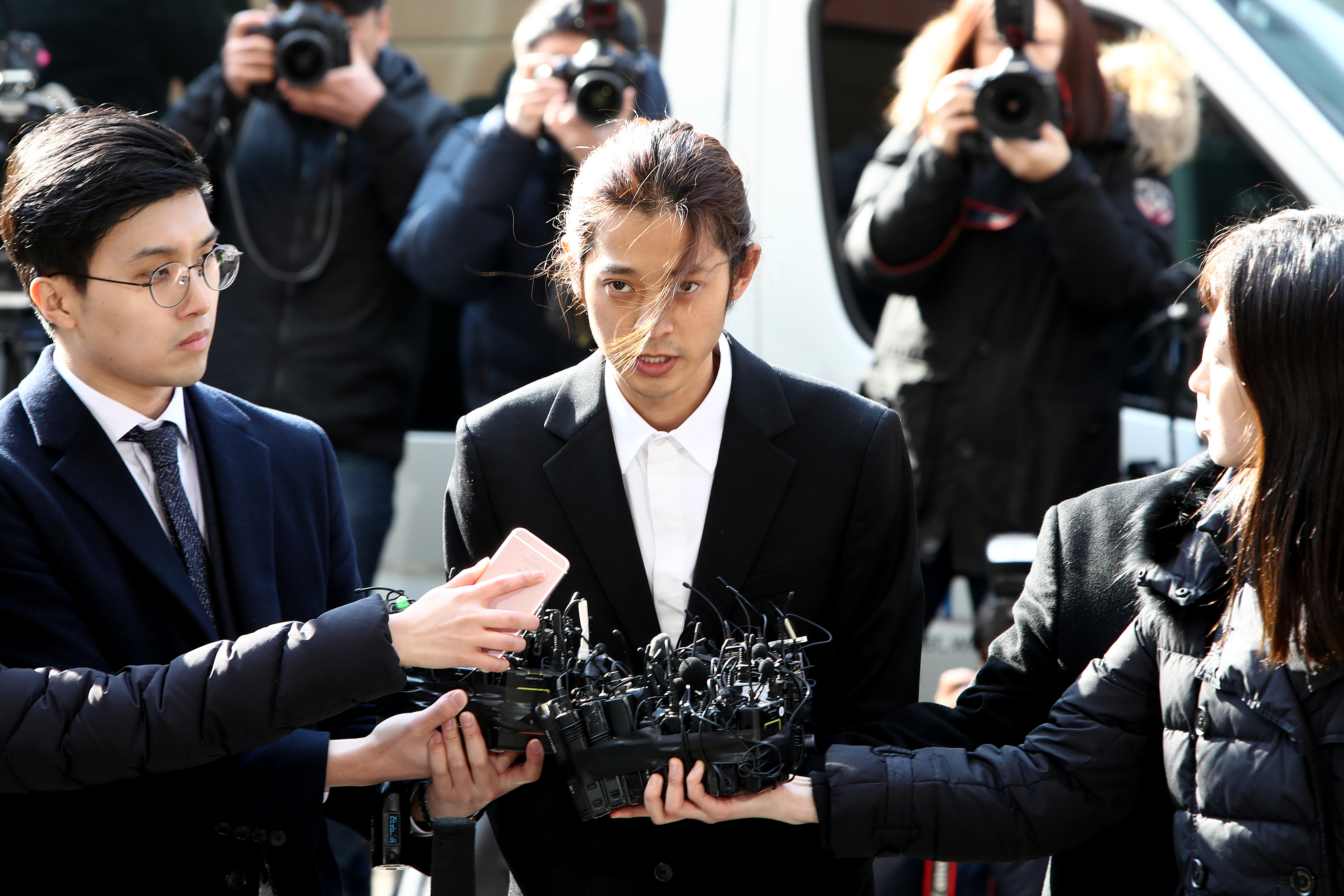 Singer Jung Joon-young is seen arriving at a Seoul Metropolitan Police Agency on March 14, 2019 in Seoul, South Korea. Jung Joon-young, a South Korean singer-songwriter and TV celebrity appeared at the police station on Thursday to be questioned over suspicions of sharing sexual videos in a group chat which included BIGBANG's member Seungri, who is facing charges of supplying prostitution services. (Photo by Chung Sung-Jun/Getty Images)