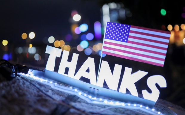 "A sign reading ""Thanks"" with a U.S. flag above is seen during a gathering at the Edinburgh place in Hong Kong, China, November 28, 2019. (REUTERS/Marko Djurica)"