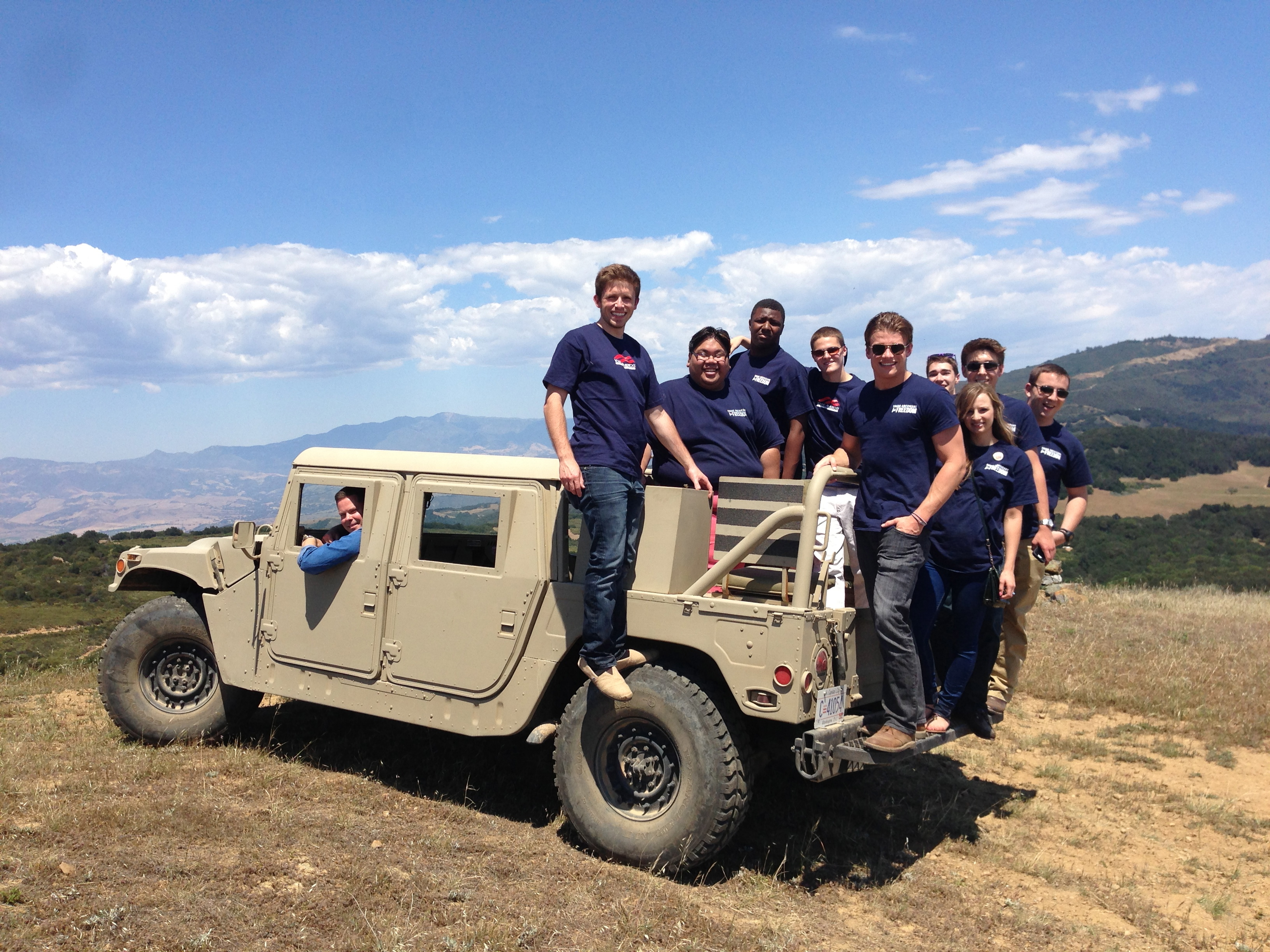YAFers pose on a Humvee driven by Andrew Coffin at Rancho del Cielo. YAF.