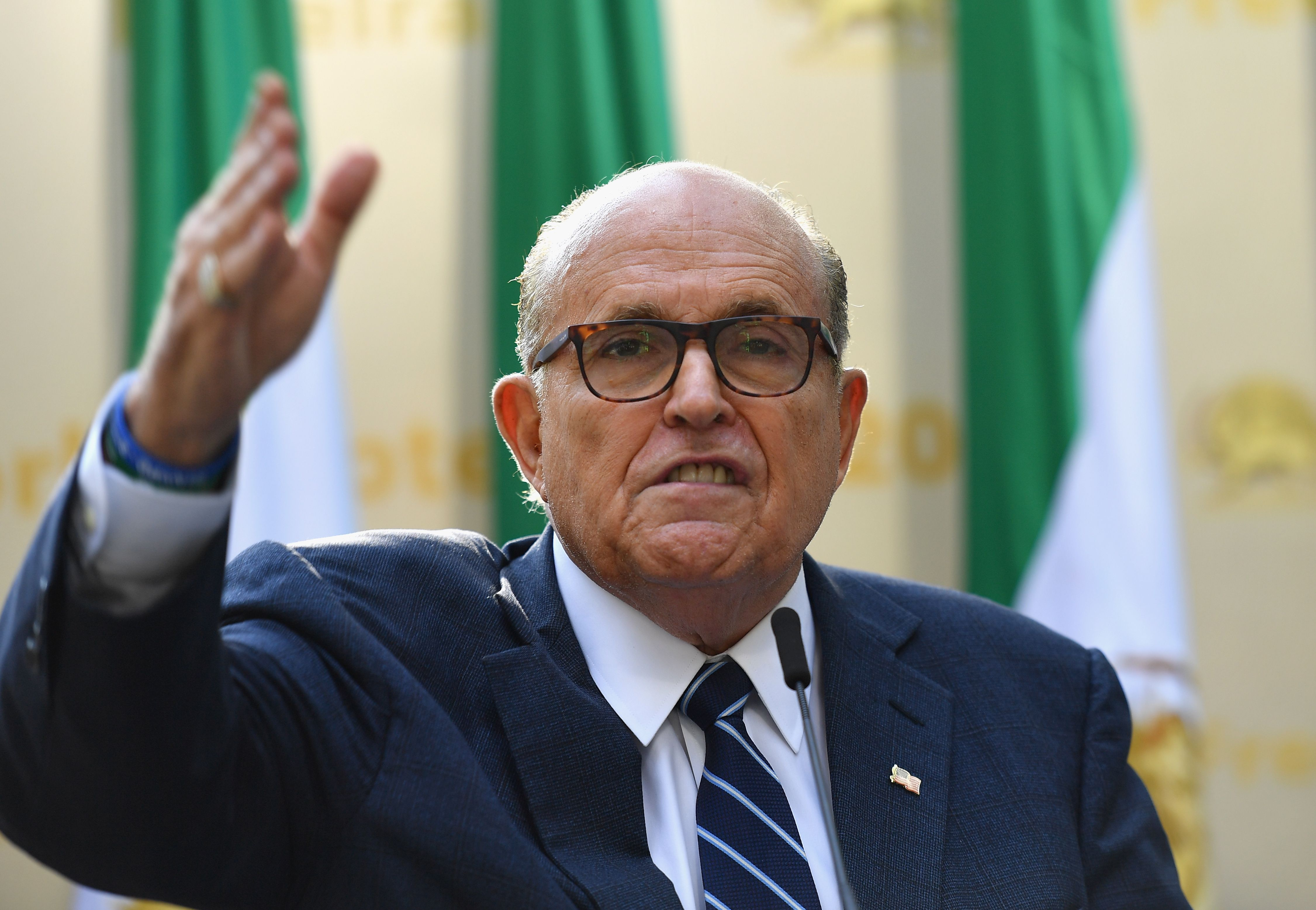 "Rudy Giuliani, Former Mayor of New York City speaks to the Organization of Iranian American Communities during their march to urge ""recognition of the Iranian people's right for regime change,"" outside the United Nations Headquarters in New York on September 24, 2019. - They urged recognition of the Iranian people's right for regime change and declared their support for the leader of democratic opposition, Maryam Rajavi. (Photo by Angela Weiss / AFP / Getty Images)"