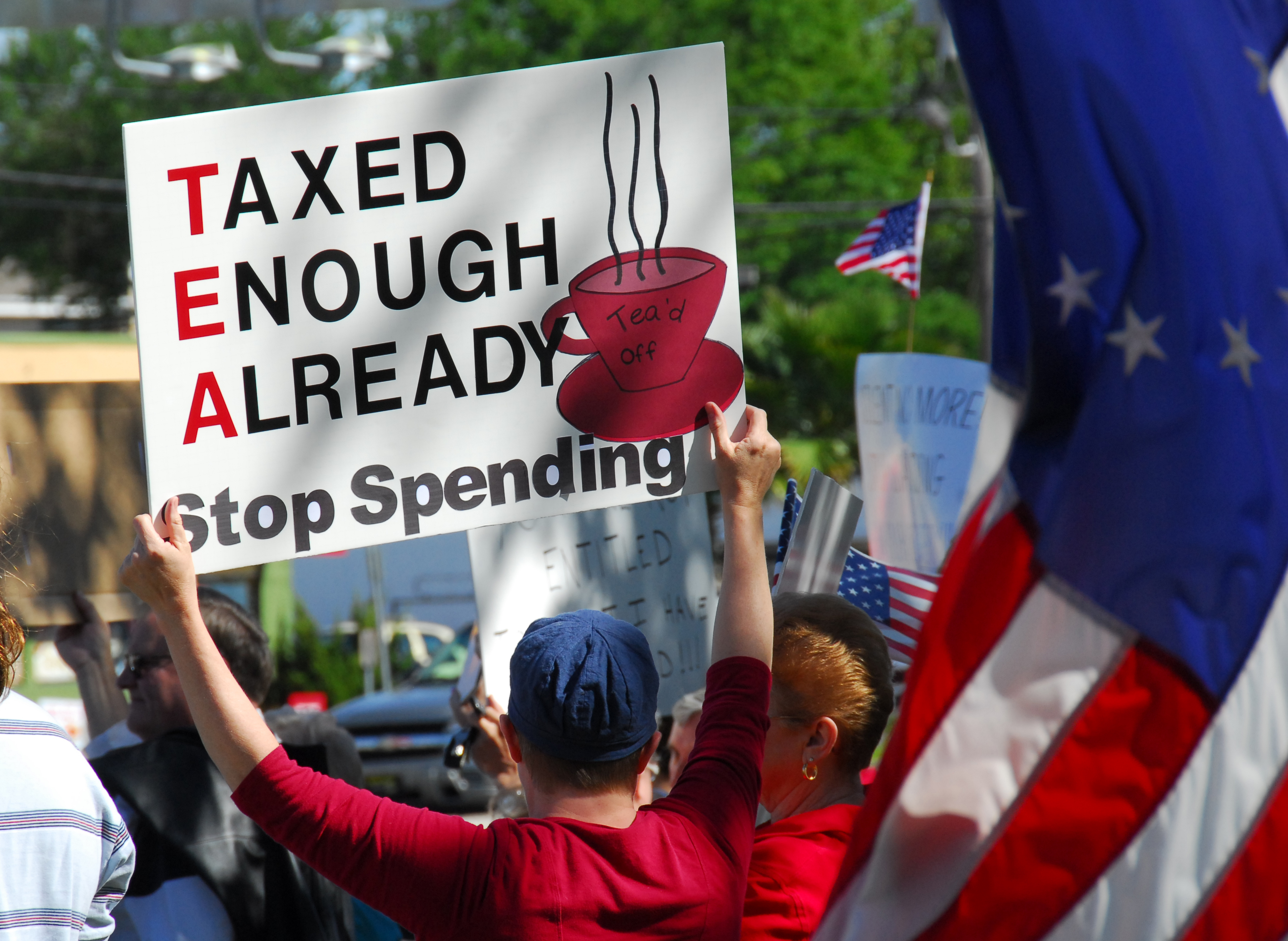 PENSACOLA, FLORIDA - APRIL 15: Protesters attend nationwide rally against increased government spending in Pensacola, Florida on tax day. Via Shutterstock.