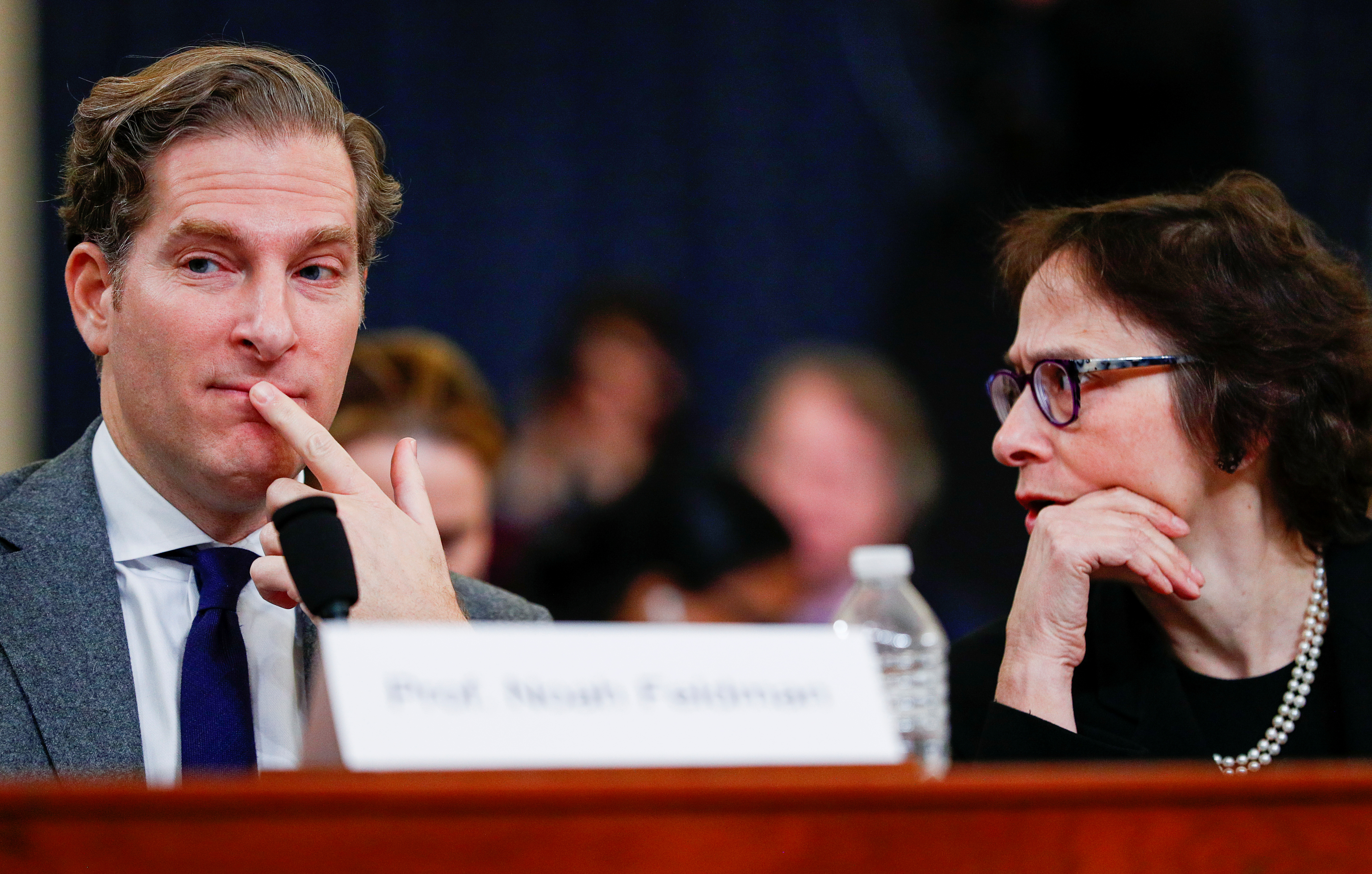 Pamela Karlan, professor of Public Interest Law and co-director of the Supreme Court Litigation Clinic at Stanford Law School, listens to Noah Feldman, professor of law and director of the Julis-Rabinowitz Program on Jewish and Israeli Law at Harvard Law School, as he testifies during a House Judiciary Committee hearing on the impeachment inquiry into U.S. President Donald Trump on Capitol Hill in Washington, U.S., Dec.4, 2019. REUTERS/Tom Brenner