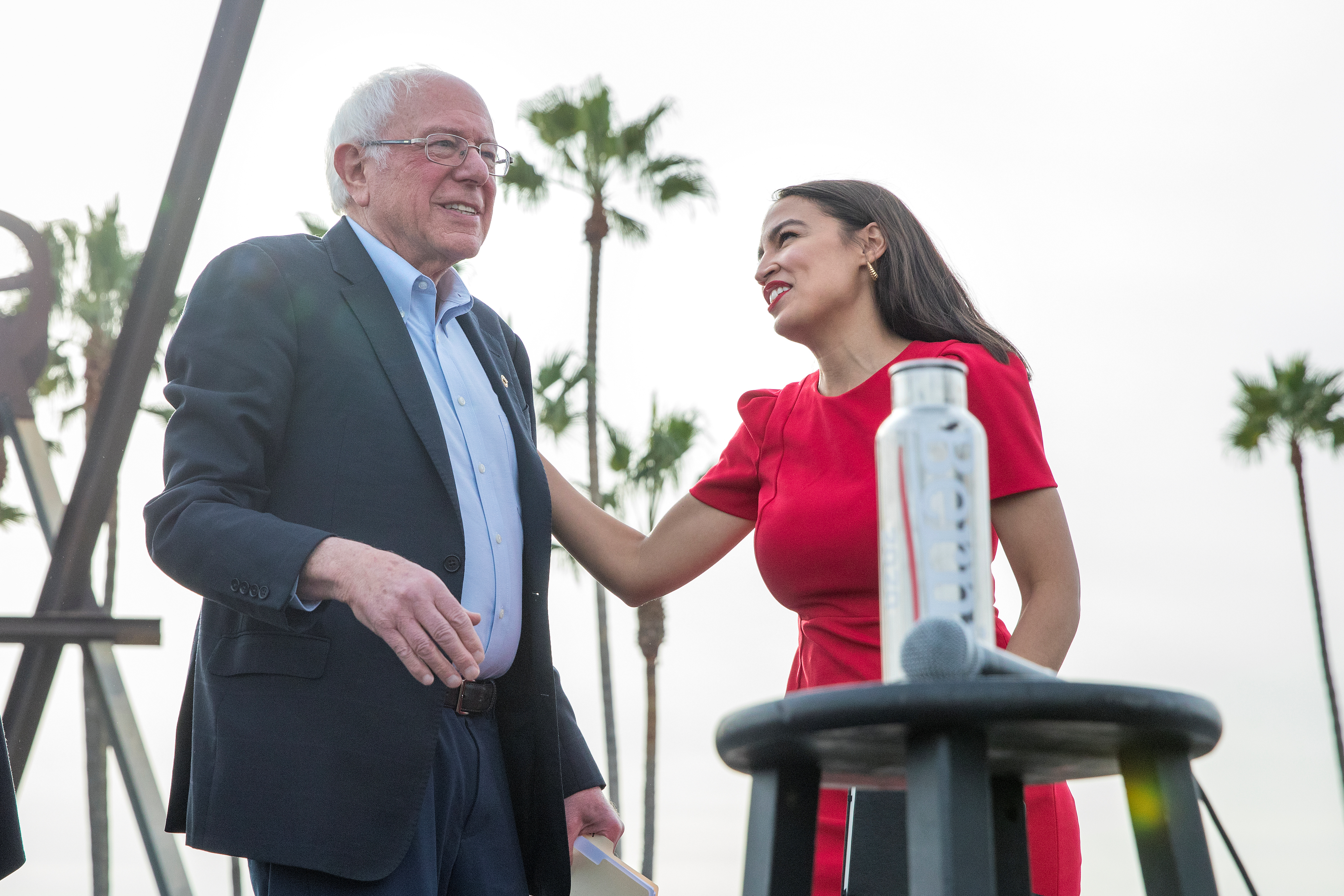 U.S. Senator Bernie Sanders and Representative Alexandria Ocasio-Cortez during a campaign rally at Venice Beach in Los Angeles, California, U.S., Dec. 21, 2019. REUTERS/Monica Almeida