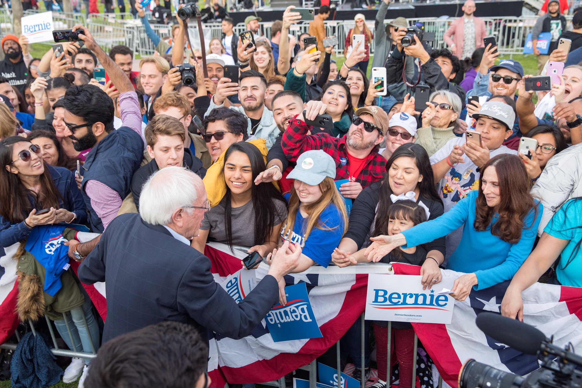 U.S. Sen Bernie Sanders greets supporters during a campaign rally at Venice Beach in Los Angeles, California, U.S., Dec. 21, 2019. REUTERS/Monica Almeida