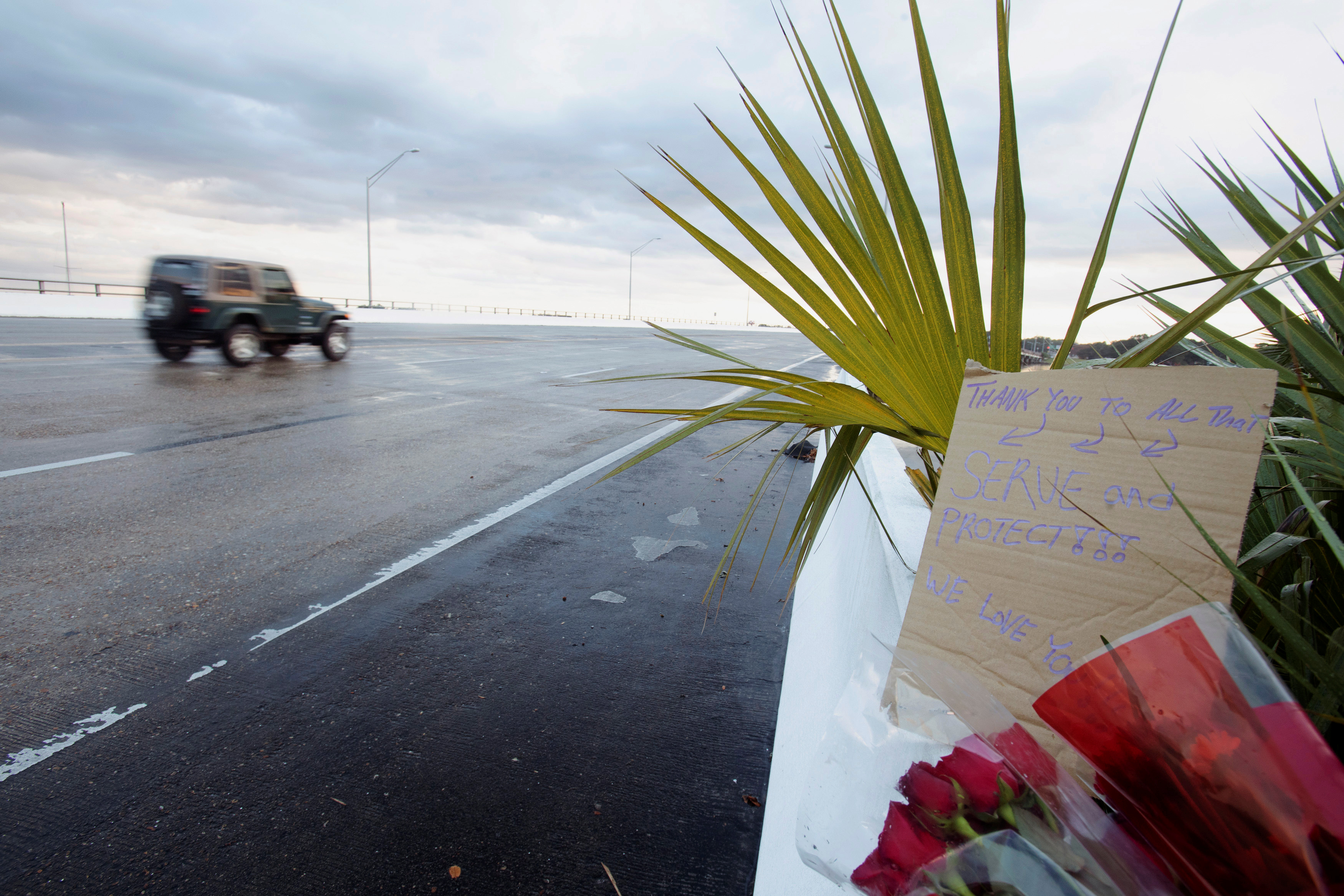 Flowers and a message are left on the entrance bridge after a member of the Saudi Air Force visiting the United States for military training was the suspect in a shooting at Naval Air Station Pensacola, in Pensacola, Florida, U.S. December 6, 2019. REUTERS/Michael Spooneybarger