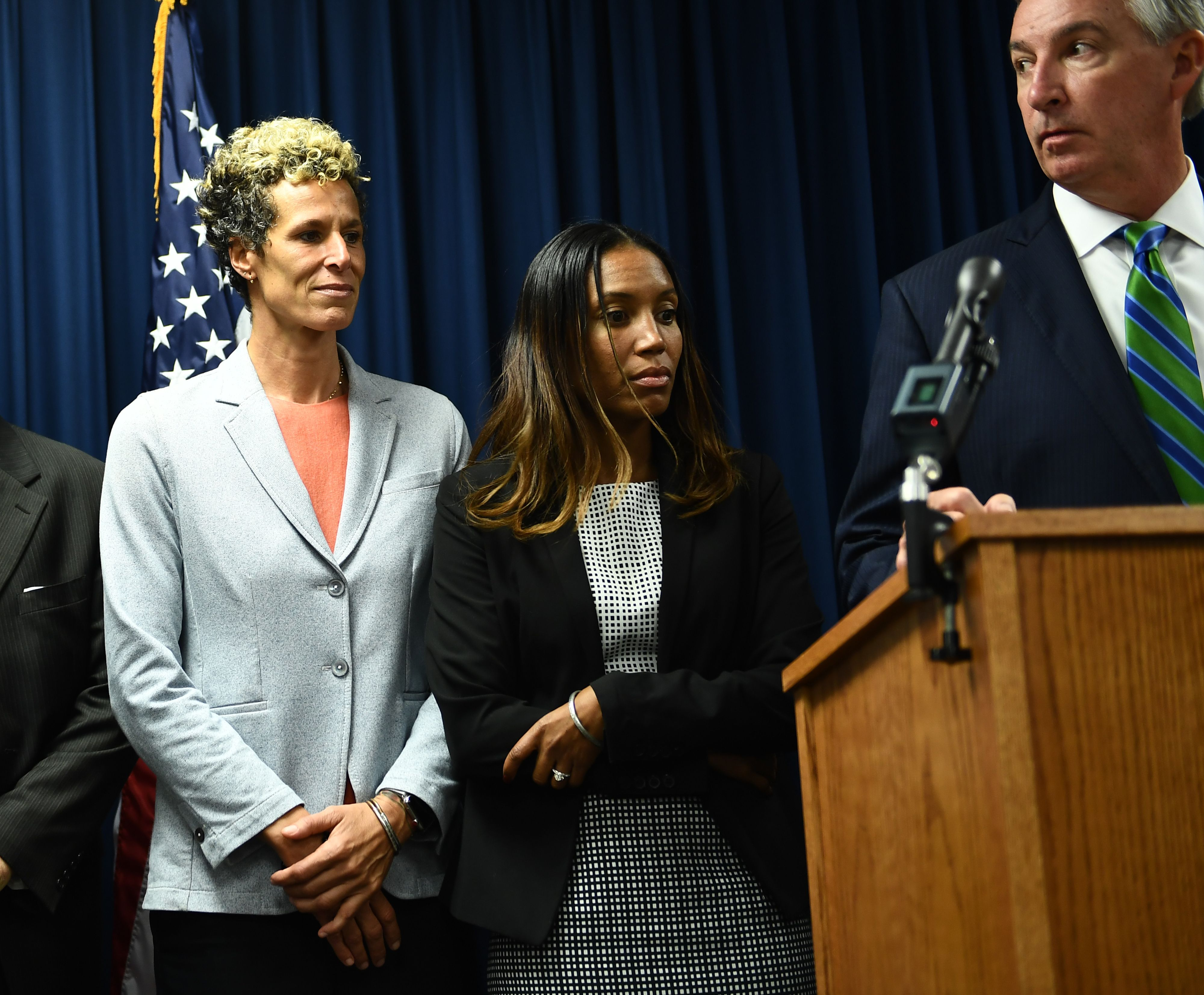 """Andrea Constand (L) attends a press conference with Montgomery County District Attorney Kevin Steele (R) on September 25, 2018 in Norristown, Pennsylvania, after comedian Bill Cosby was sentenced to at least three years in prison and branded a """"sexually violent predator"""" for assaulting a woman at his Philadelphia mansion 14 years ago. - The 81-year-old, once beloved by millions as """"America's Dad,"""" is the first celebrity convicted and sentenced for a sex crime since the downfall of Harvey Weinstein ushered in the #MeToo movement and America's reckoning with sexual harassment. (Photo credit should read BRENDAN SMIALOWSKI/AFP via Getty Images)"""