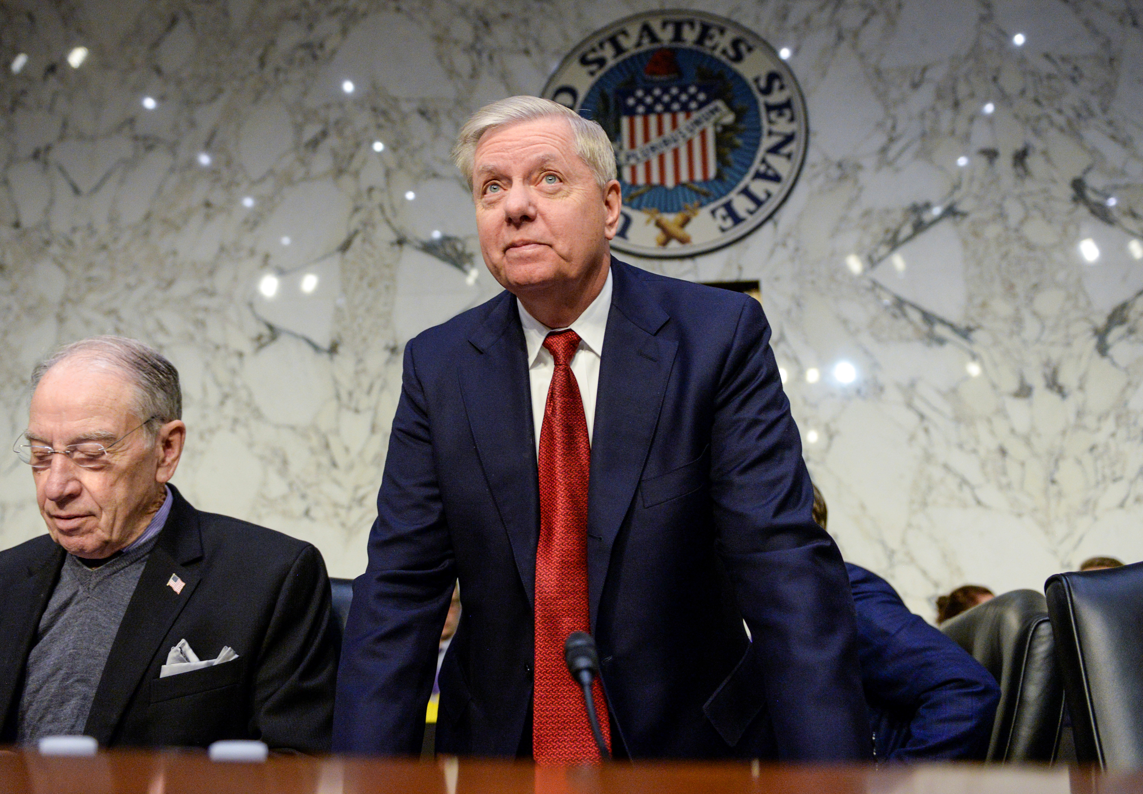 "U.S. Senate Judiciary Committee Chairman Senator Lindsey Graham (R-SC) arrives next to a seat Sen. Chuck Grassley (R-IA) prior to hearing testimony from Justice Department Inspector General Michael Horowitz before a Senate Judiciary Committee hearing ""Examining the Inspector General's report on alleged abuses of the Foreign Intelligence Surveillance Act (FISA)"" on Capitol Hill in Washington, U.S., December 11, 2019. REUTERS/Erin Scott -"