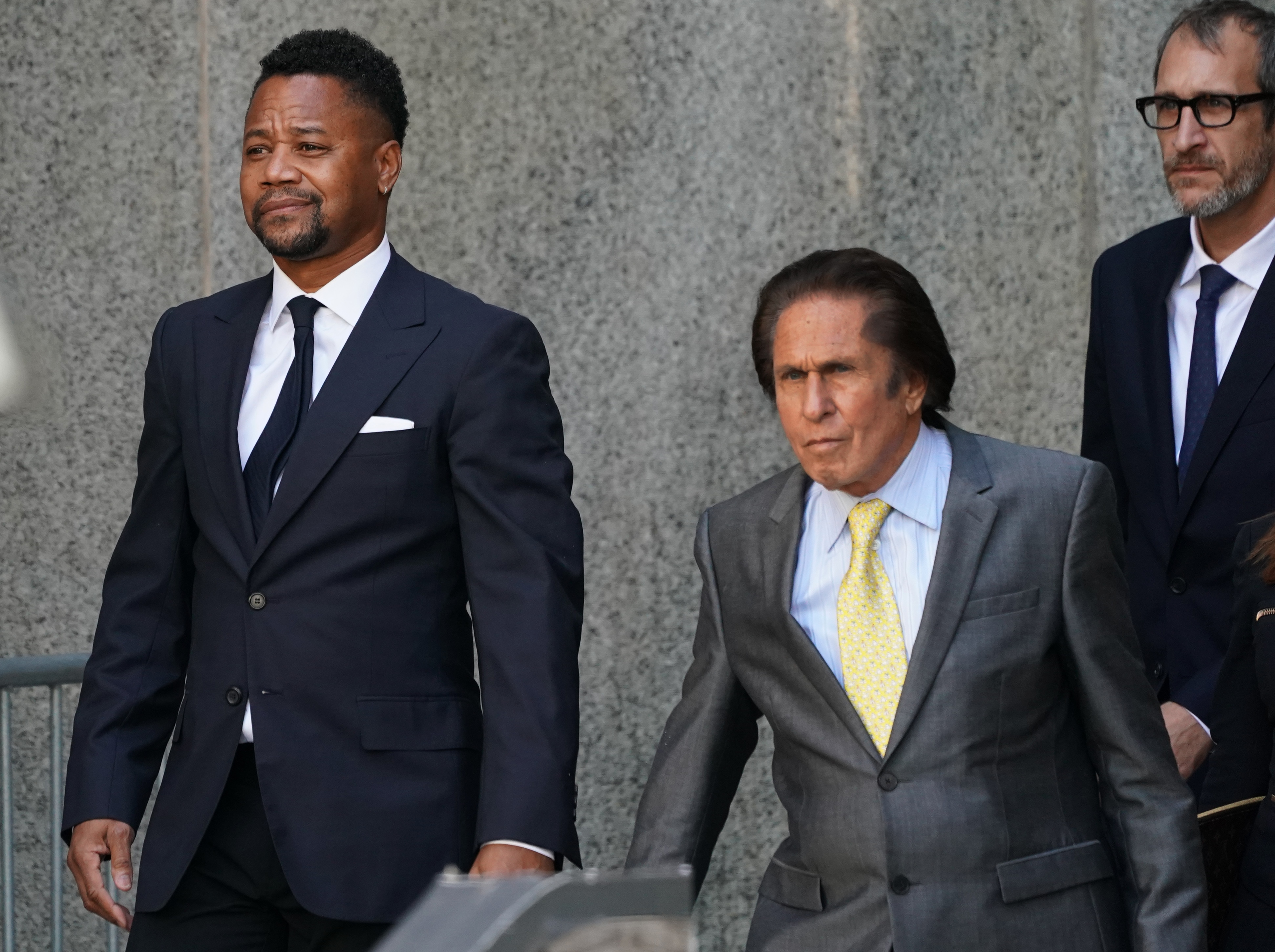 Oscar-winning actor Cuba Gooding Jr. (L), departs his court arraignment with his lawyer Mark Hellerin (C) New York October 15, 2019, in New York on October 15, 2019. - Gooding has previously been charged with forcible touching and sex abuse in relation to an alleged groping incident at a New York bar. (Photo by TIMOTHY A. CLARY/AFP via Getty Images)