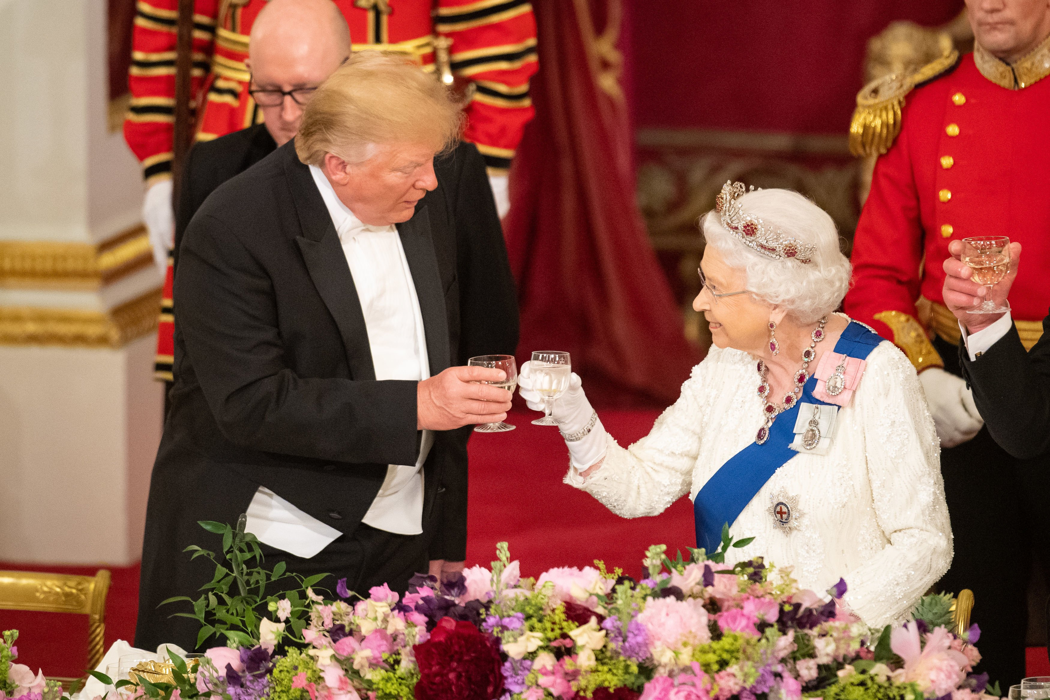 U.S. President Donald Trump and Queen Elizabeth II make a toast during a State Banquet at Buckingham Palace on June 3, 2019 in London, England. President Trump's three-day state visit will include lunch with the Queen, and a State Banquet at Buckingham Palace, as well as business meetings with the Prime Minister and the Duke of York, before travelling to Portsmouth to mark the 75th anniversary of the D-Day landings. (Photo by Dominic Lipinski- WPA Pool/Getty Images)