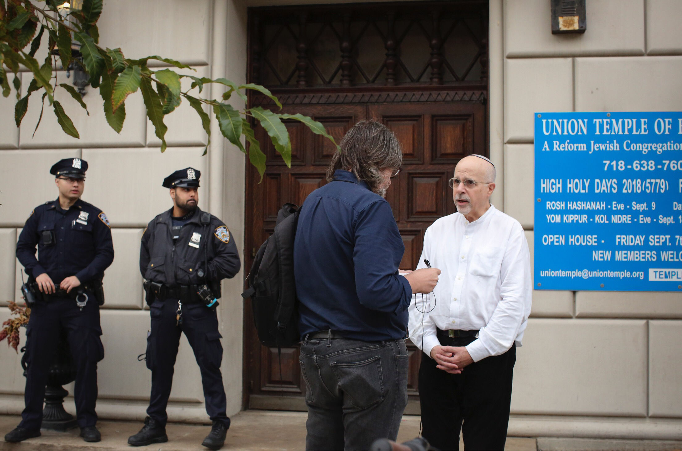 Rabbi Mark Sameth speaks with members of the Media as NYPD officers stand guard at the door of the Union Temple of Brooklyn on November 2, 2018 in New York City. - New York police were investigating anti-Semitic graffiti found inside a Brooklyn synagogue that forced the cancellation of a political event less than a week after the worst anti-Semitic attack in modern US history. (Photo: KENA BETANCUR/AFP via Getty Images)