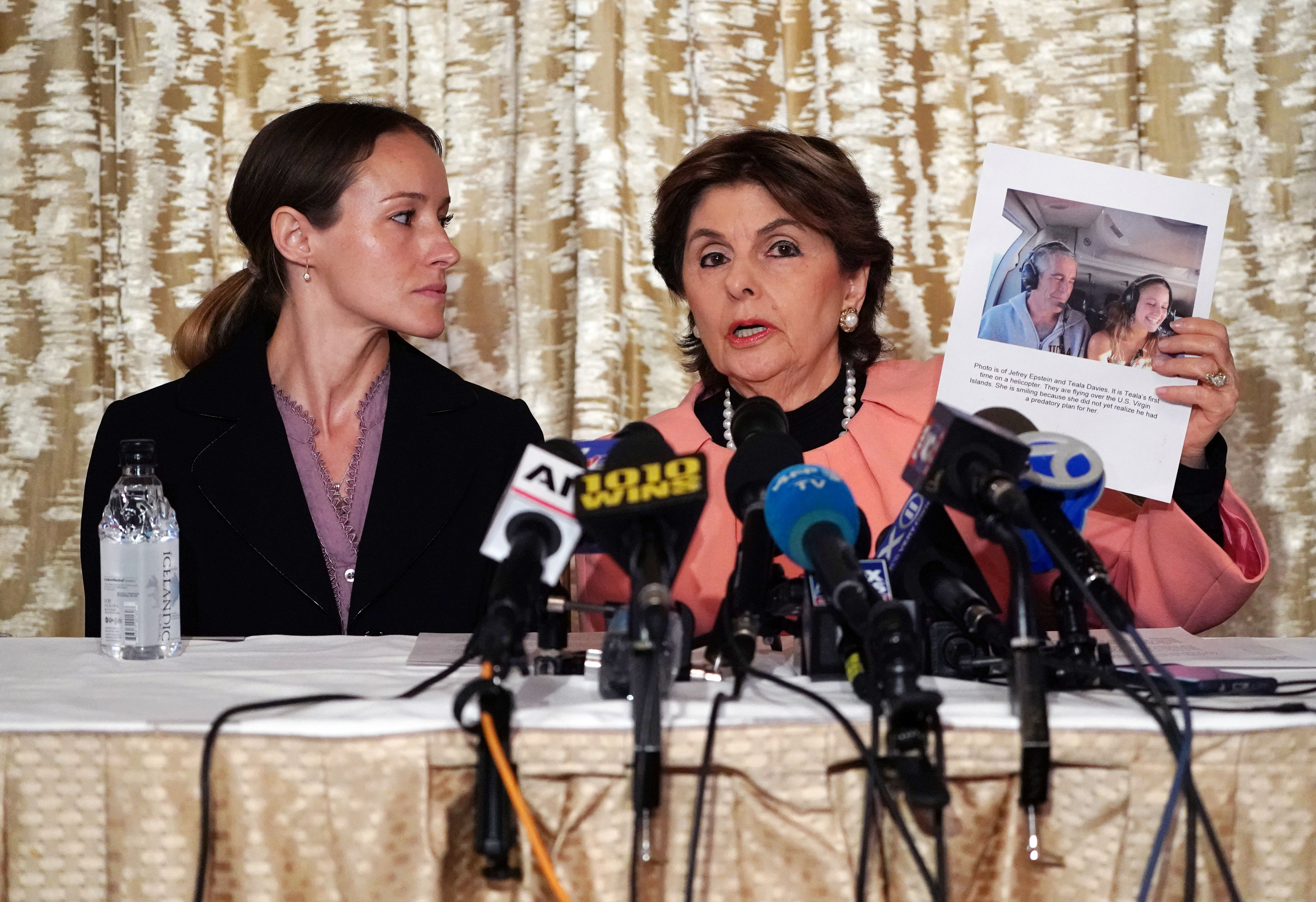 Attorney Gloria Allred (R) and her client Teala Davies, who claims to be a victim of sexual abuse by Jeffrey Epstein when she was a minor, hold a press conference in New York City on November 21, 2019. (TIMOTHY A. CLARY/AFP via Getty Images)
