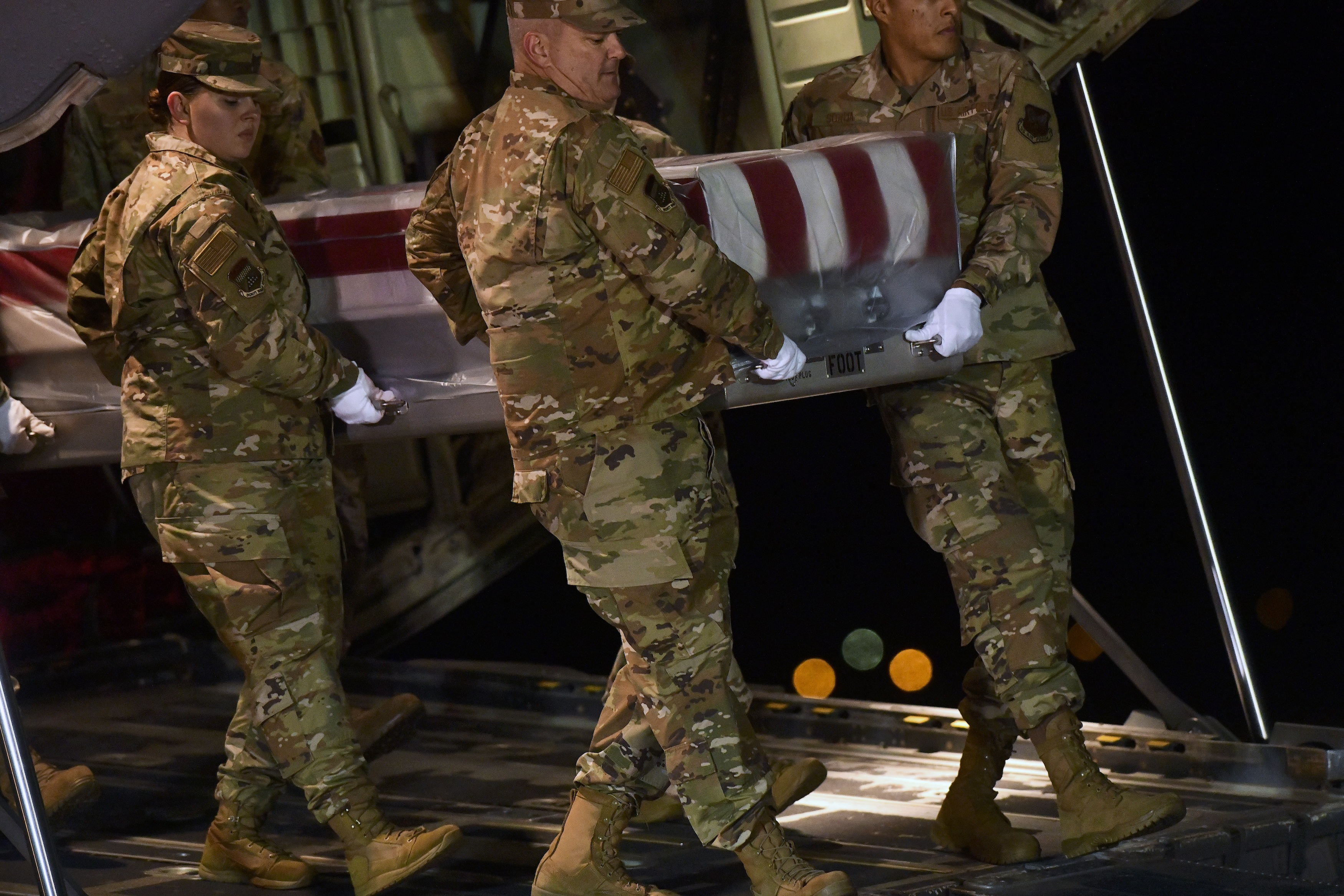 Military personnel carry a transfer case for fallen service member, U.S. Navy Seaman Apprentice Cameron S. Walters, 21, during a dignified transfer at Dover Air Force Base on December 8, 2019 in Dover, Delaware.(Mark Makela/Getty Images)