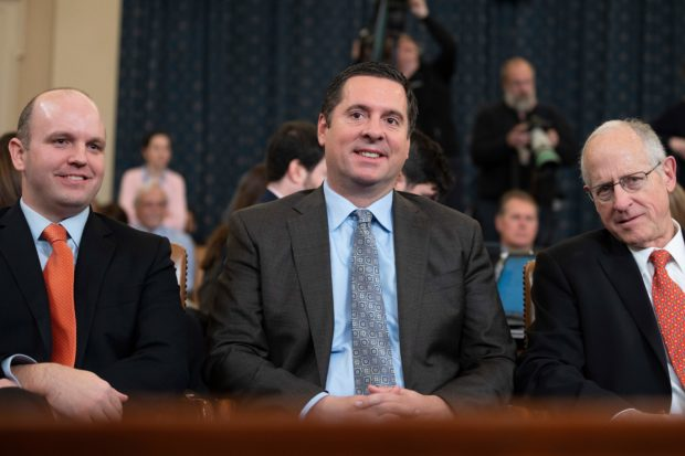 House Intelligence Committee Ranking Member Devin Nunes (C) arrives for Majority Counsel Barry Berke and Minority Counsel Stephen Castor testimony during the House Judiciary Committee hearing as part of the impeachment inquiry into US President Donald Trump on Capitol Hill in Washington,DC on December 9, 2019. - The impeachment proceedings against President Donald Trump in a sharply divided US Congress enter a new phase Monday when the House Judiciary Committee convenes a hearing expected to result in specific charges against the Republican leader. (Photo by JIM WATSON / AFP) (Photo by JIM WATSON/AFP via Getty Images)
