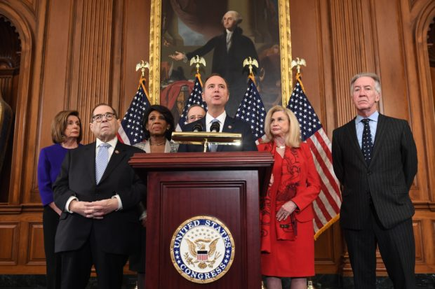 House Permanent Select Committee on Intelligence Chairman Adam Schiff (C) (D-CA), flanked by House Speaker Nancy Pelosi (L), House Judiciary Chairman Jerry Nadler (2nd L) (D-NY), House Foreign Affairs Committee Chairman Eliot Engel (R) (D-NY), House Financial Services Committee Chairwoman Maxine Waters (3rd L) (D-CA), House Committee on Oversight and Reform Chairwoman Carolyn Maloney (2nd R) (D-NY), speaks as Democrats announced articles of impeachment against US President Donald Trump during a press conference at the US Capitol in Washington, DC, December 10, 2019 listing abuse of power and obstruction of Congress. (Photo by SAUL LOEB/AFP via Getty Images)
