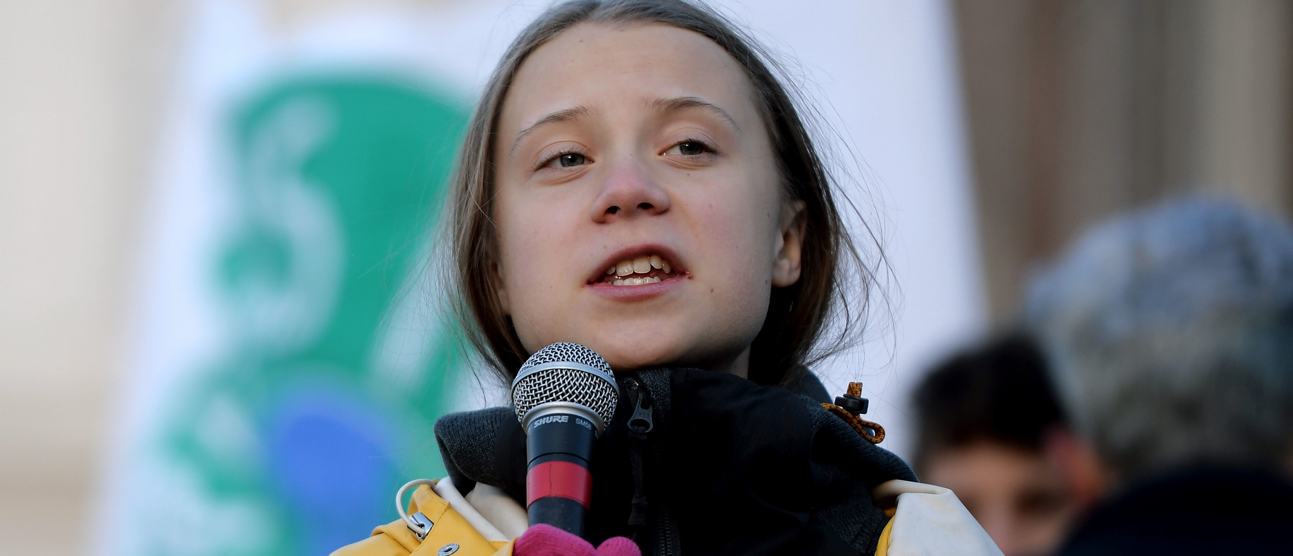 Swedish climate activist Greta Thunberg gives a speech during the Friday for Future strike on climate emergency, in Turin, on December 13, 2019. - Greta Thunberg, the teenager who became the voice of a generation facing the climate change emergency, was named Time magazine's 2019 Person of the Year. Unknown to the world when she launched a solo strike against global warming in mid-2018, the 16-year-old has since inspired millions in a worldwide movement that saw her tipped as a Nobel laureate. (Photo by Filippo MONTEFORTE / AFP) (Photo by FILIPPO MONTEFORTE/AFP via Getty Images)