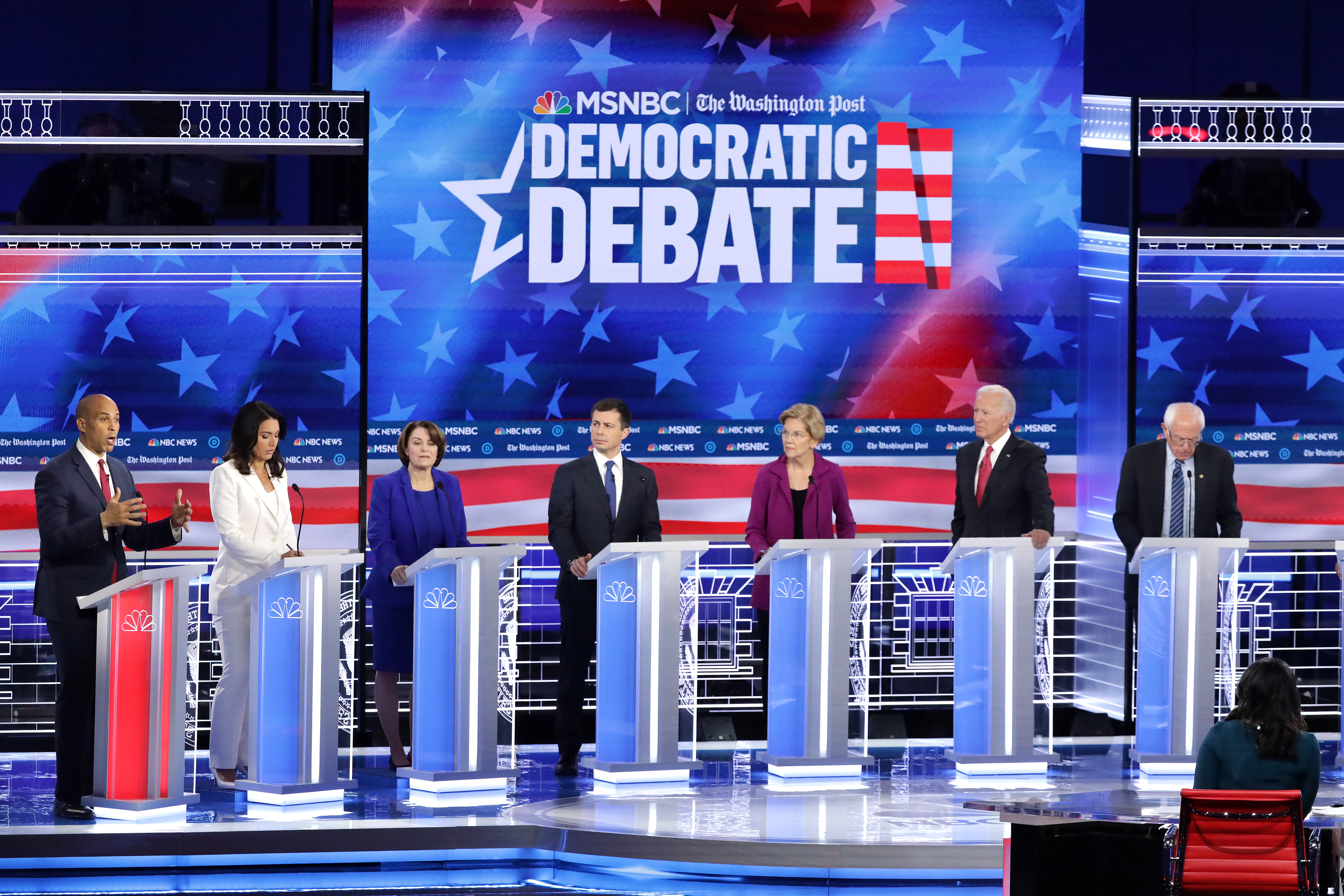 ATLANTA, GEORGIA - NOVEMBER 20: Democratic presidential candidates (L-R) Rep. Tulsi Gabbard (D-HI) Sen. Amy Klobuchar (D-MN), South Bend, Indiana Mayor Pete Buttigieg, Sen. Elizabeth Warren (D-MA), Former Vice President Joe Biden and Sen. Bernie Sanders (I-VT) listen as Sen. Cory Booker (D-NJ) ( far L) during the Democratic Presidential Debate at Tyler Perry Studios November 20, 2019 in Atlanta, Georgia. Ten Democratic presidential hopefuls were chosen from the larger field of candidates to participate in the debate hosted by MSNBC and The Washington Post. (Photo by Alex Wong/Getty Images)