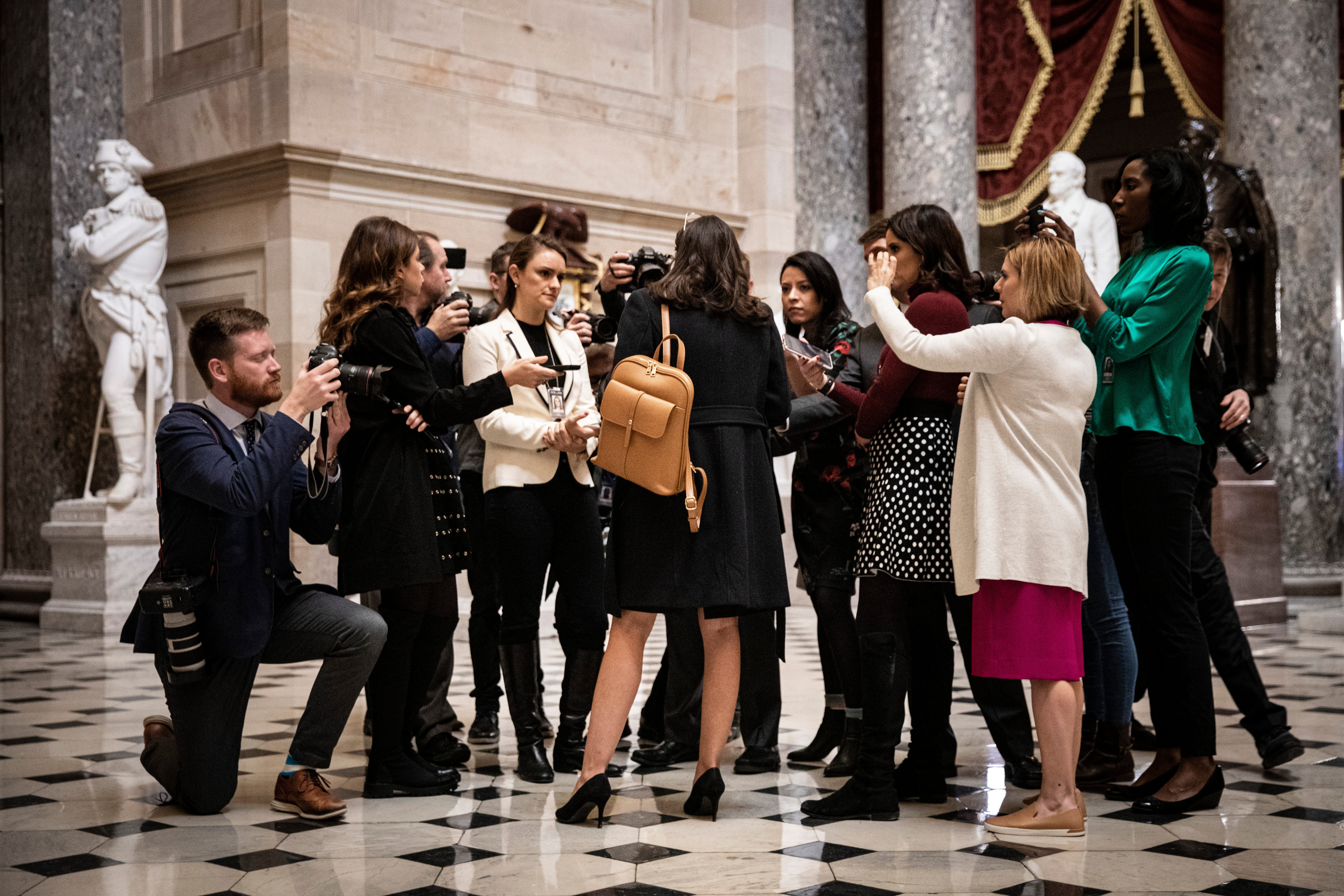 Rep. Alexandria Ocasio-Cortez (D-NY) speaks to reporters in Statuary Hall at the U.S. Capitol on December 18, 2019 in Washington, DC. (Drew Angerer/Getty Images)