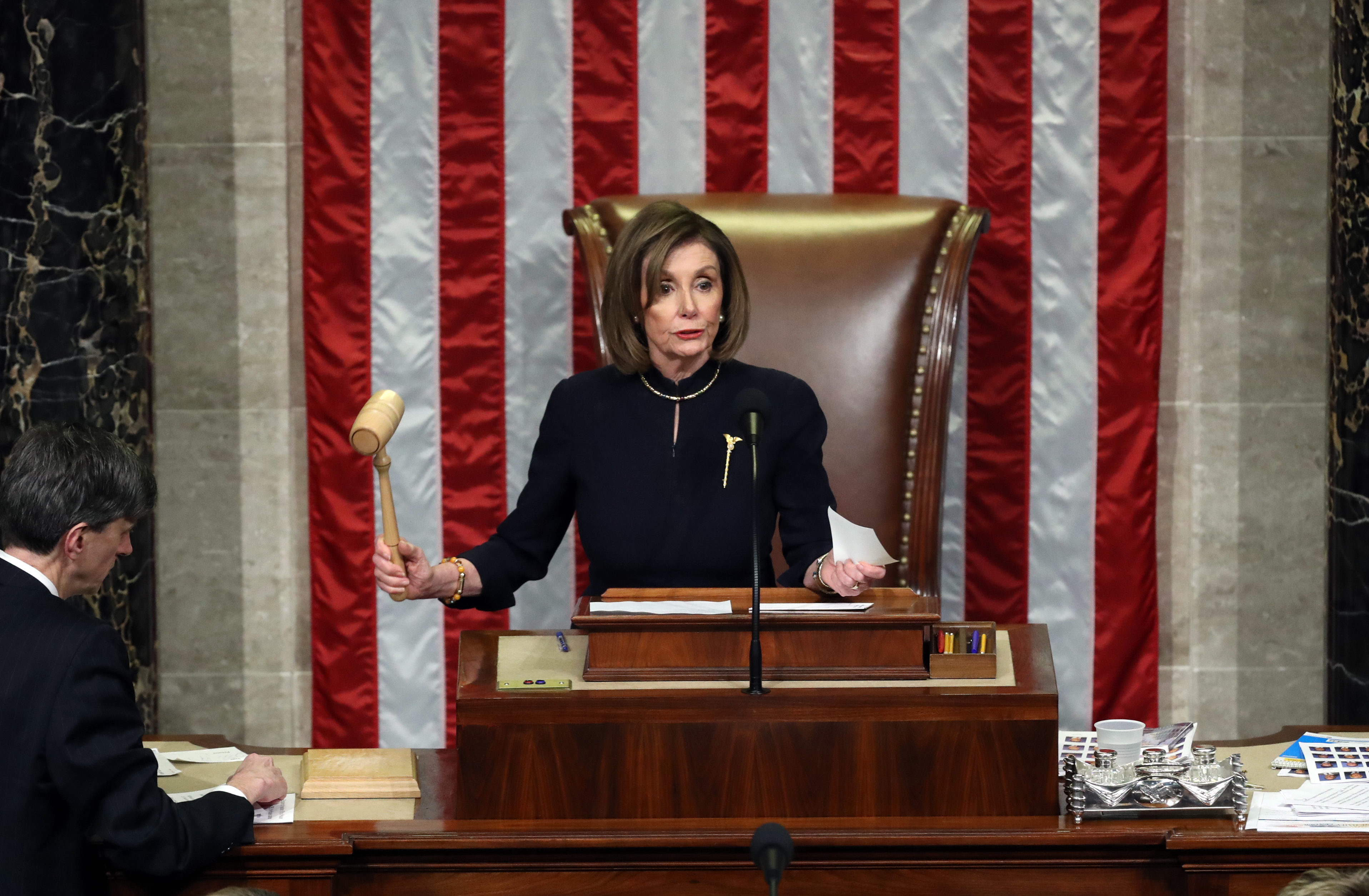 WASHINGTON, DC - DECEMBER 18: Speaker of the House Nancy Pelosi (D-CA) presides over Resolution 755 as the House of Representatives votes on the second article of impeachment of US President Donald Trump at in the House Chamber at the US Capitol Building on December 18, 2019 in Washington, DC. The U.S. House of Representatives voted to successfully pass two articles of impeachment against President Donald Trump on charges of abuse of power and obstruction of Congress. (Photo by Chip Somodevilla/Getty Images)