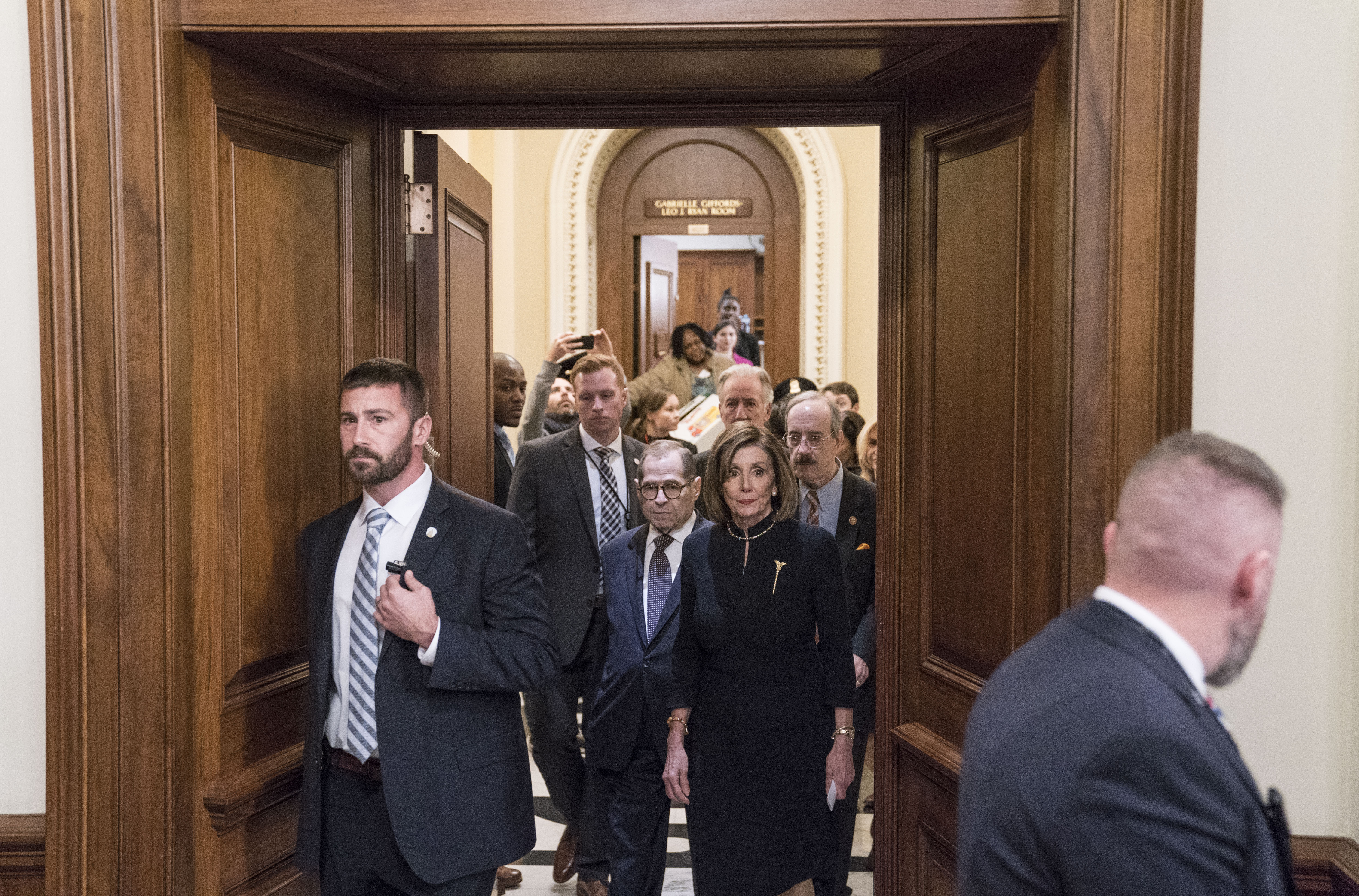 WASHINGTON, DC - DECEMBER 18: Speaker of the House Nancy Pelosi (D-CA) arrives to the Rayburn Room of the US Capitol to deliver remarks following the House of Representatives vote to impeach President Donald Trump on December 18, 2019 in Washington, DC. On Wednesday evening, the U.S. House of Representatives voted 230 to 197 and 229 to 198 to impeach President Trump on two articles of impeachment charging him with abuse of power and obstruction of Congress. (Photo by Sarah Silbiger/Getty Images)