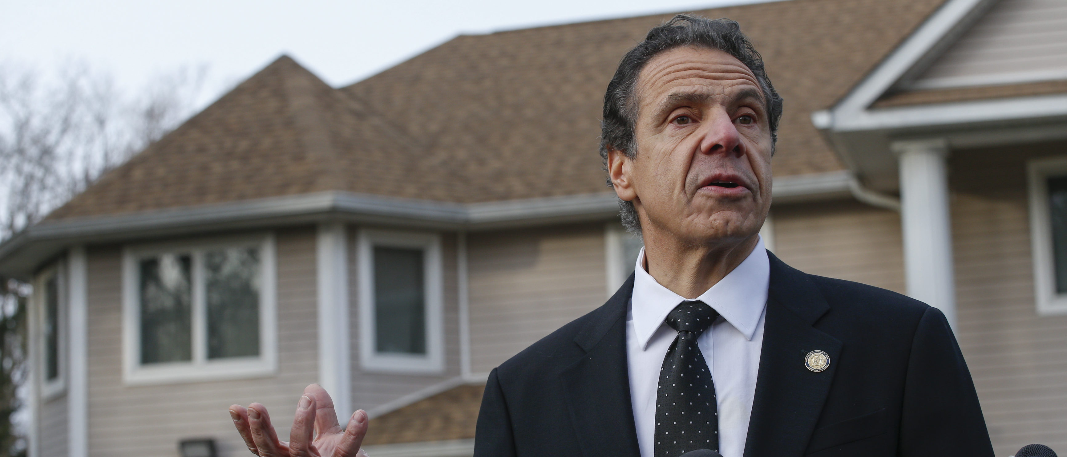 New York Governor Andrew Cuomo speaks to the media outside the home of rabbi Chaim Rottenbergin Monsey, in New York on December 29, 2019. (KENA BETANCUR/AFP via Getty Images)