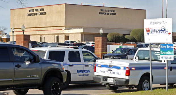 WHITE SETTLEMENT, TX - DECEMBER 29: Law enforcement vehicles are parked outside West Freeway Church of Christ where a shooting took place at the morning service on December 29, 2019 in White Settlement, Texas. The gunman was killed by armed members of the church after he opened fire during Sunday services. According to reports, a security guard was killed by the gunman. (Photo by Stewart F. House/Getty Images)