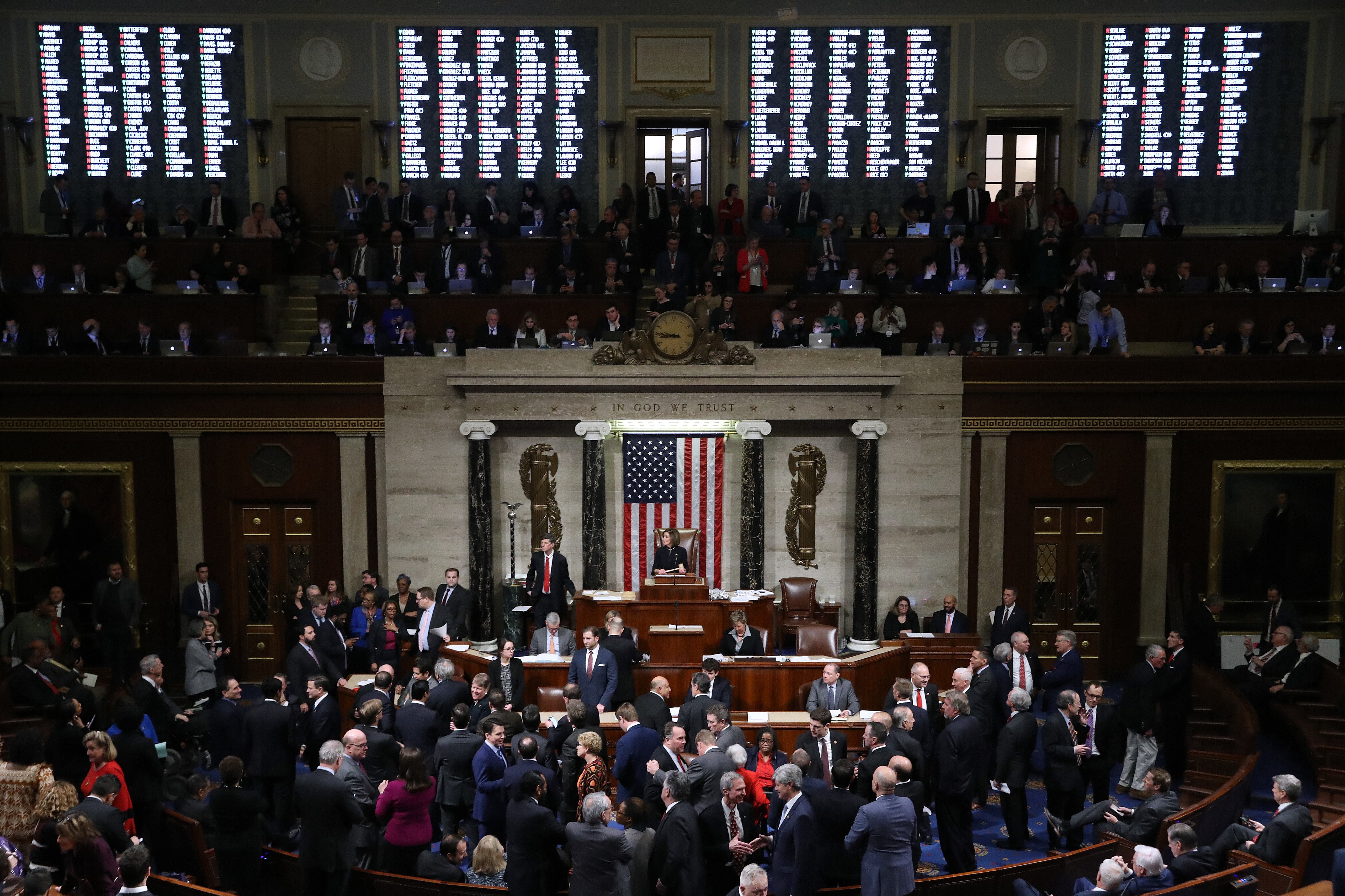 WASHINGTON, DC - DECEMBER 18: The vote count is projected on the walls of the House of Representatives as Speaker of the House Nancy Pelosi (D-CA) presides over voting on the second article of impeachment of U.S. President Donald Trump at in the House Chamber at the U.S. Capitol December 18, 2019 in Washington, DC. The U.S. House of Representatives voted to successfully pass two articles of impeachment against President Donald Trump on charges of abuse of power and obstruction of Congress. (Photo by Chip Somodevilla/Getty Images)